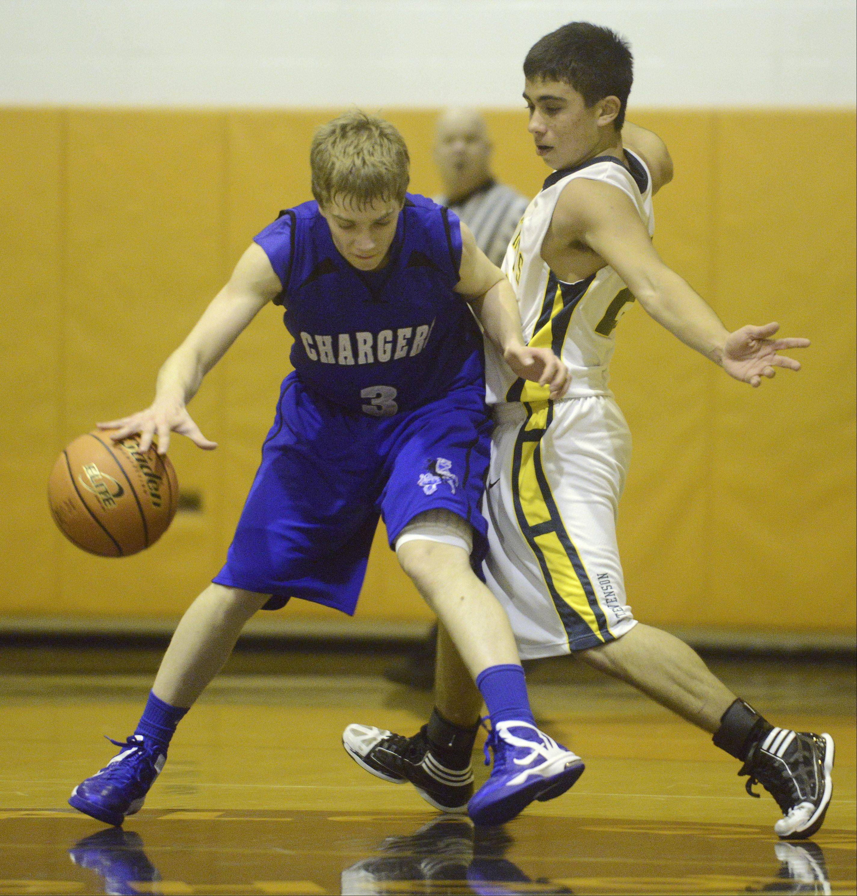 Christian Liberty Academy's Ben Daniel, left, is closely guarded by Stevenson's Justin Berkson during Wednesday's game at Buffalo Grove.