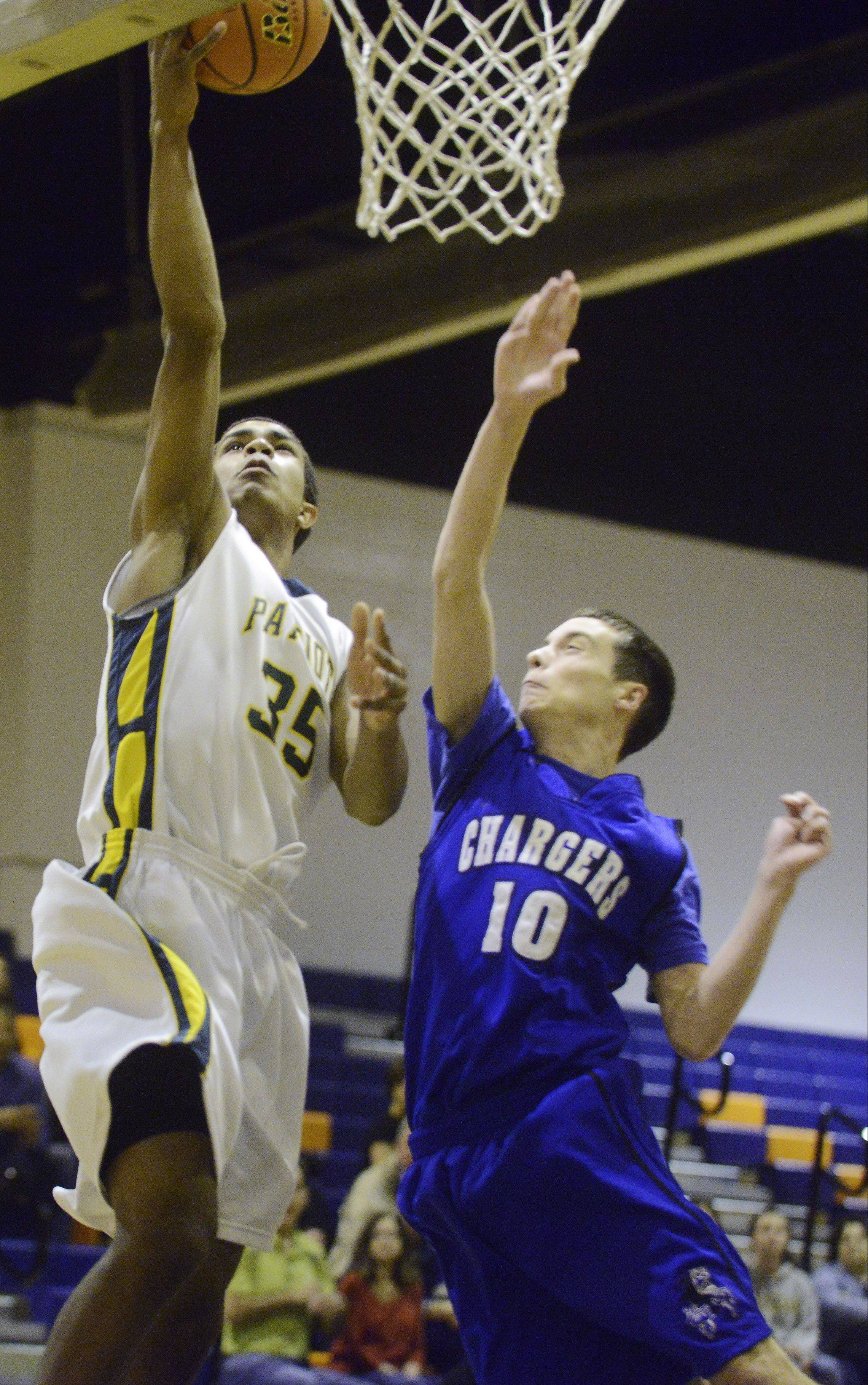 Stevenson's Connor Cashaw drives to the basket for a layup ahead of Christian Liberty Academy defender Jack Salsgiver.