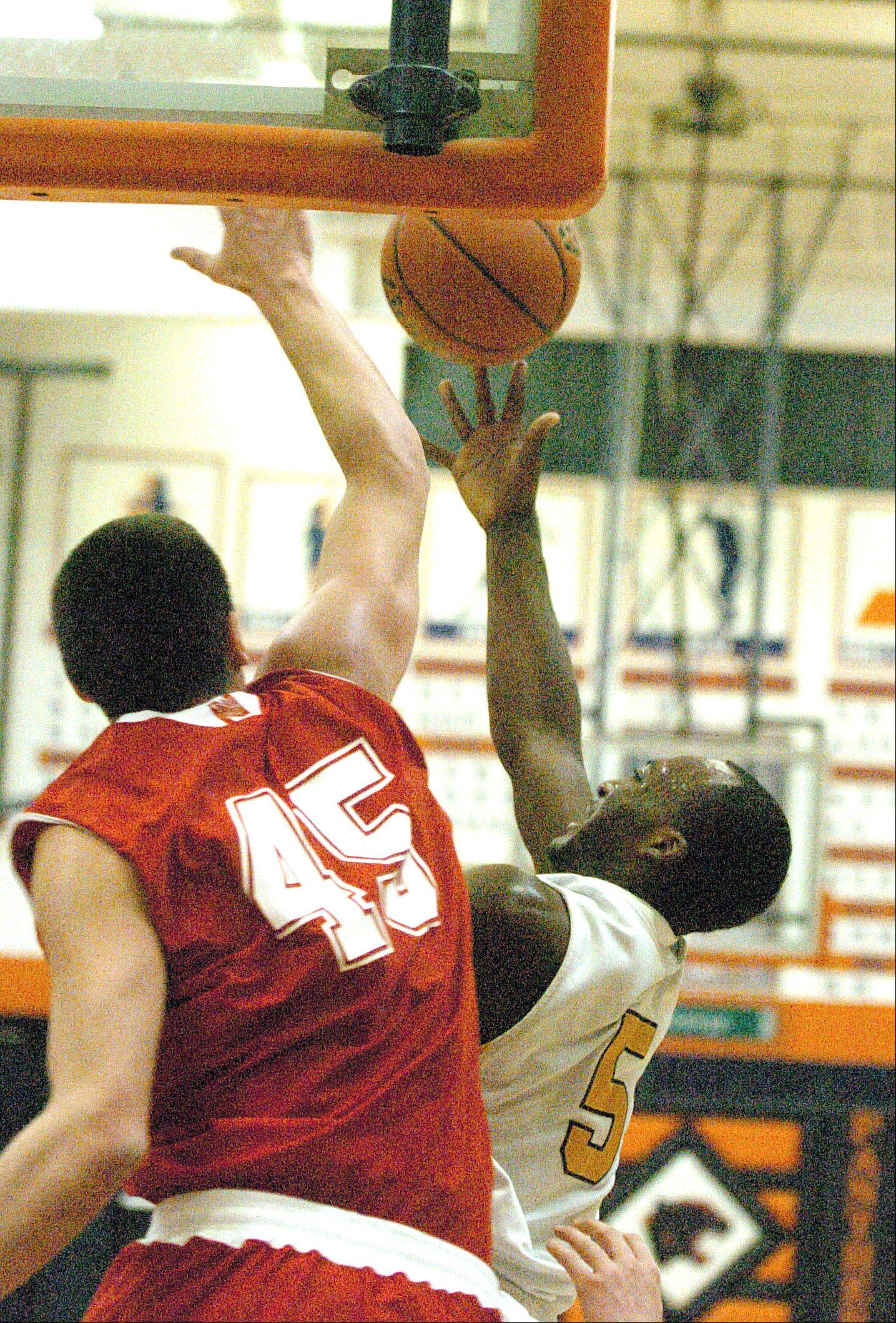 Nick Czarnowski of Naperville Central tries to stop Trayvond Taylor of Metea during the Metea Valley vs. Naperville Central boys basketball game at Hoops for Healing Tournament in Oswego Wednesday.