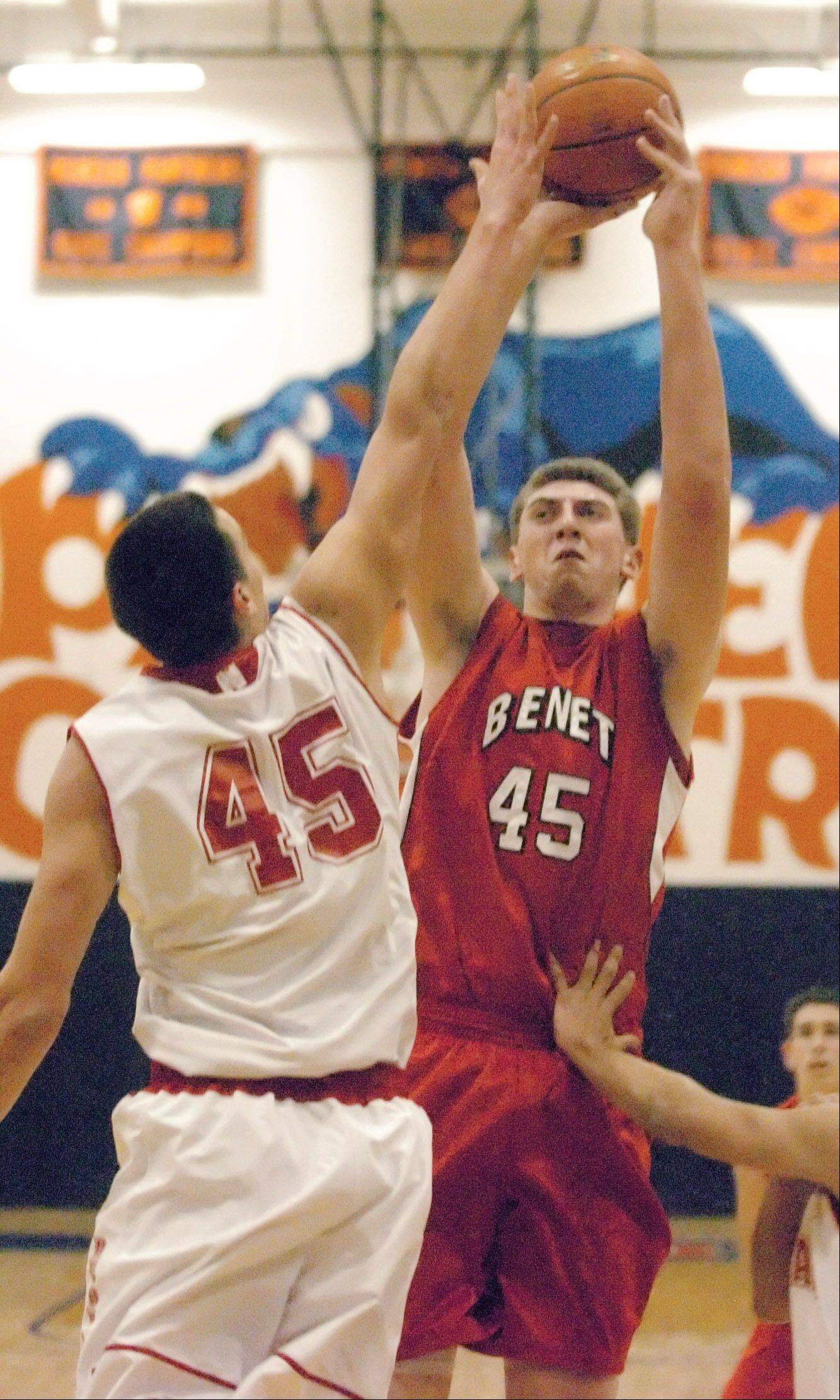 Nick Czarnowski of Naperville,left, and Sean O'Mara of Benet take part in the Benet vs. Naperville Central Hoops for Healing tournament in Oswego Friday.