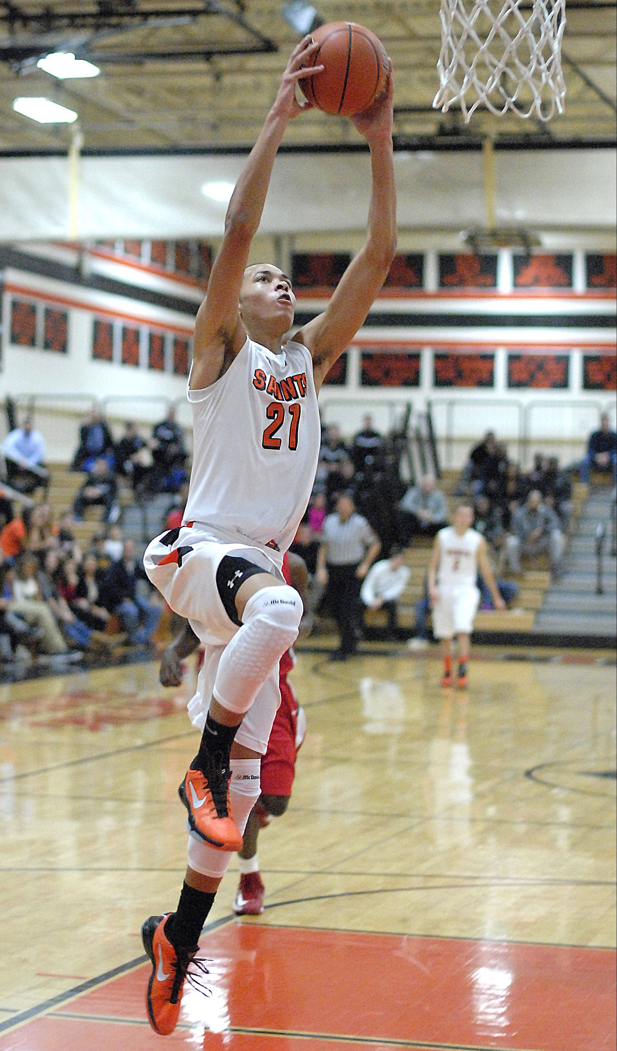 Kendall Stephens lays in 2 of his 31 points in St. Charles East's 71-53 victory over St. Joseph Friday night in St. Charles.