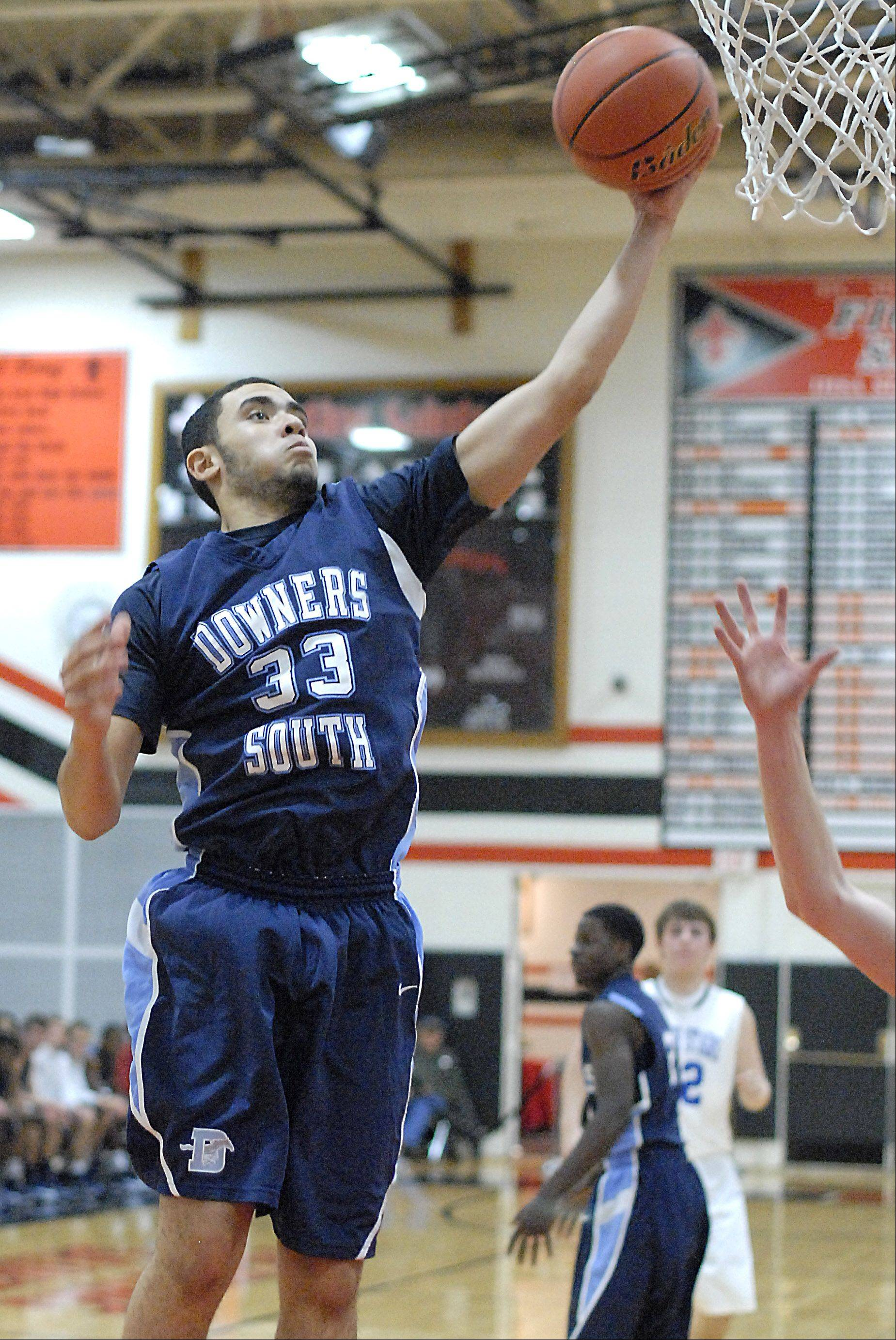 Downers Grove South's Jordan Cannon grabs a rebound in the third quarter on Friday, November 23.