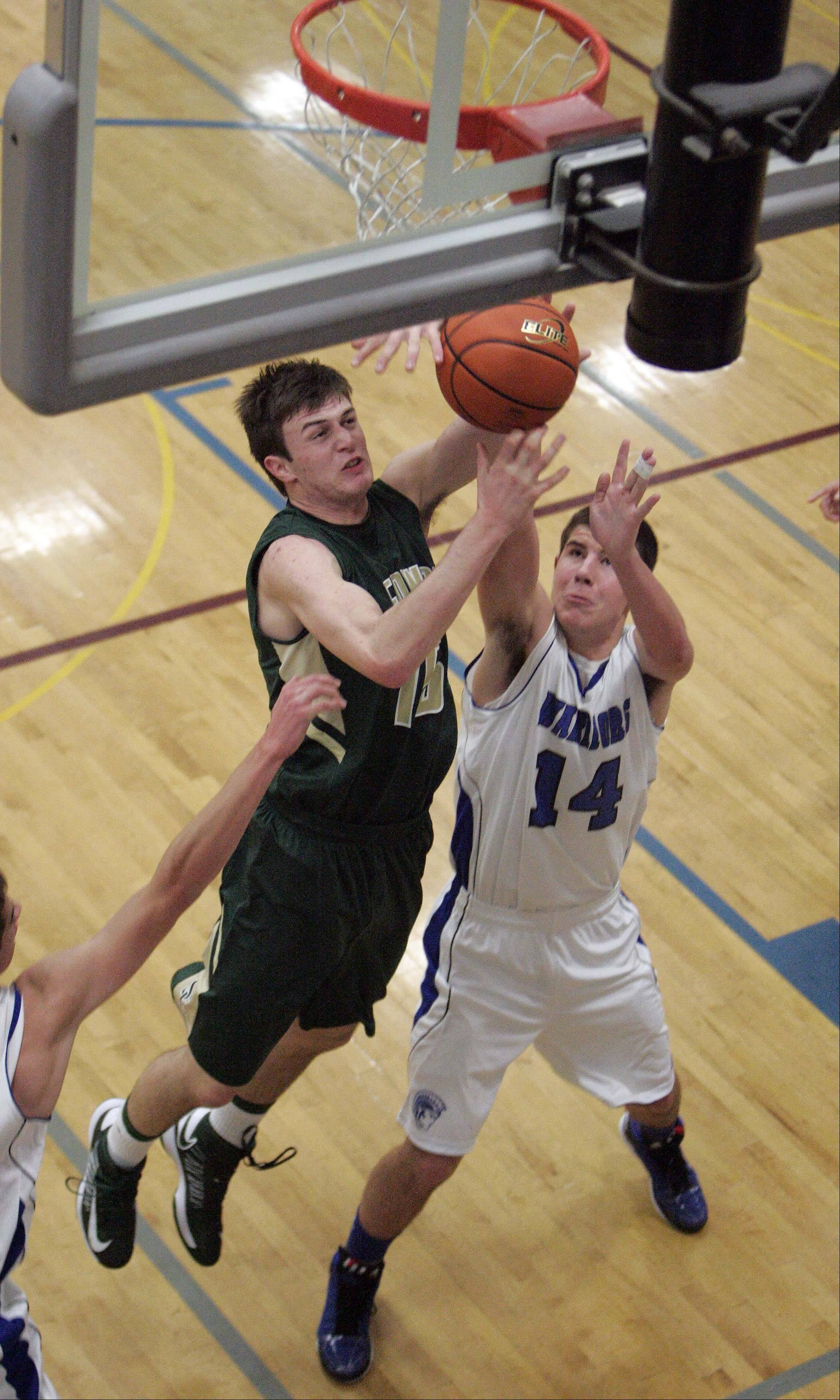 St. Edward forward Nick Duffy (15) battles at the hoop for a rebound with Westminster Christian' s Sam Carani (14) during the 6th Annual Warrior Thanksgiving Basketball Classic in Elgin Friday November 23, 2012.