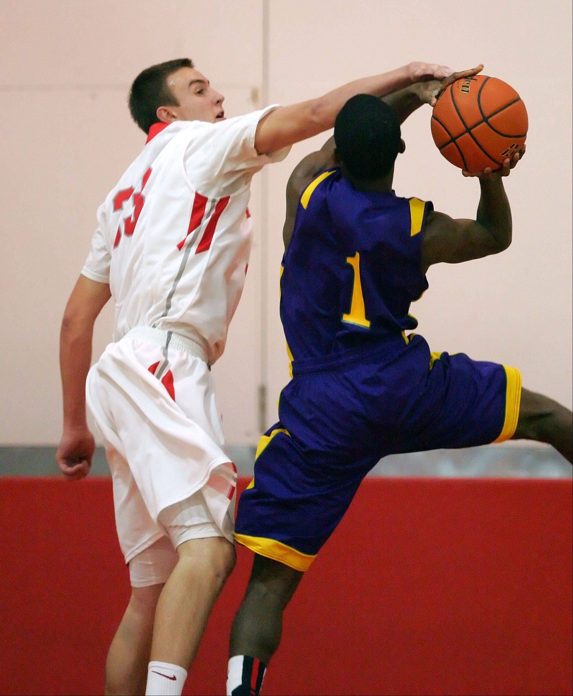 Mundelein's Sean O'Brien, left, defends against Waukegan's Jordan Johnson on Friday night at Mundelein.