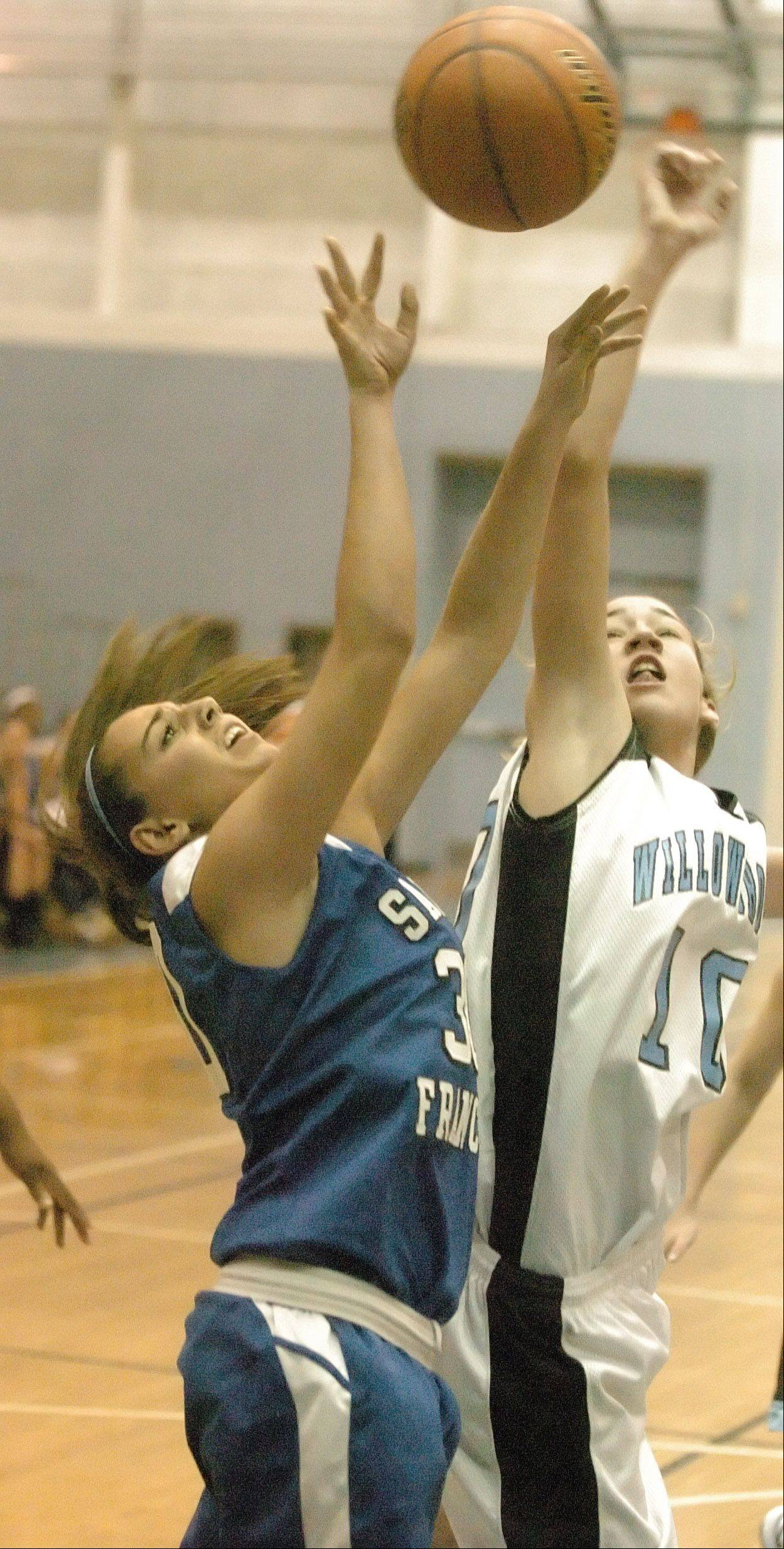 Aly Germanos of St. Francis and Molly Krawczykowski of Willowbrook fight for the ball. This took place during the St. Francis at Willowbrook 19th Annual Willowbrook Lady Warriors Thanksgiving Invite Thursday.
