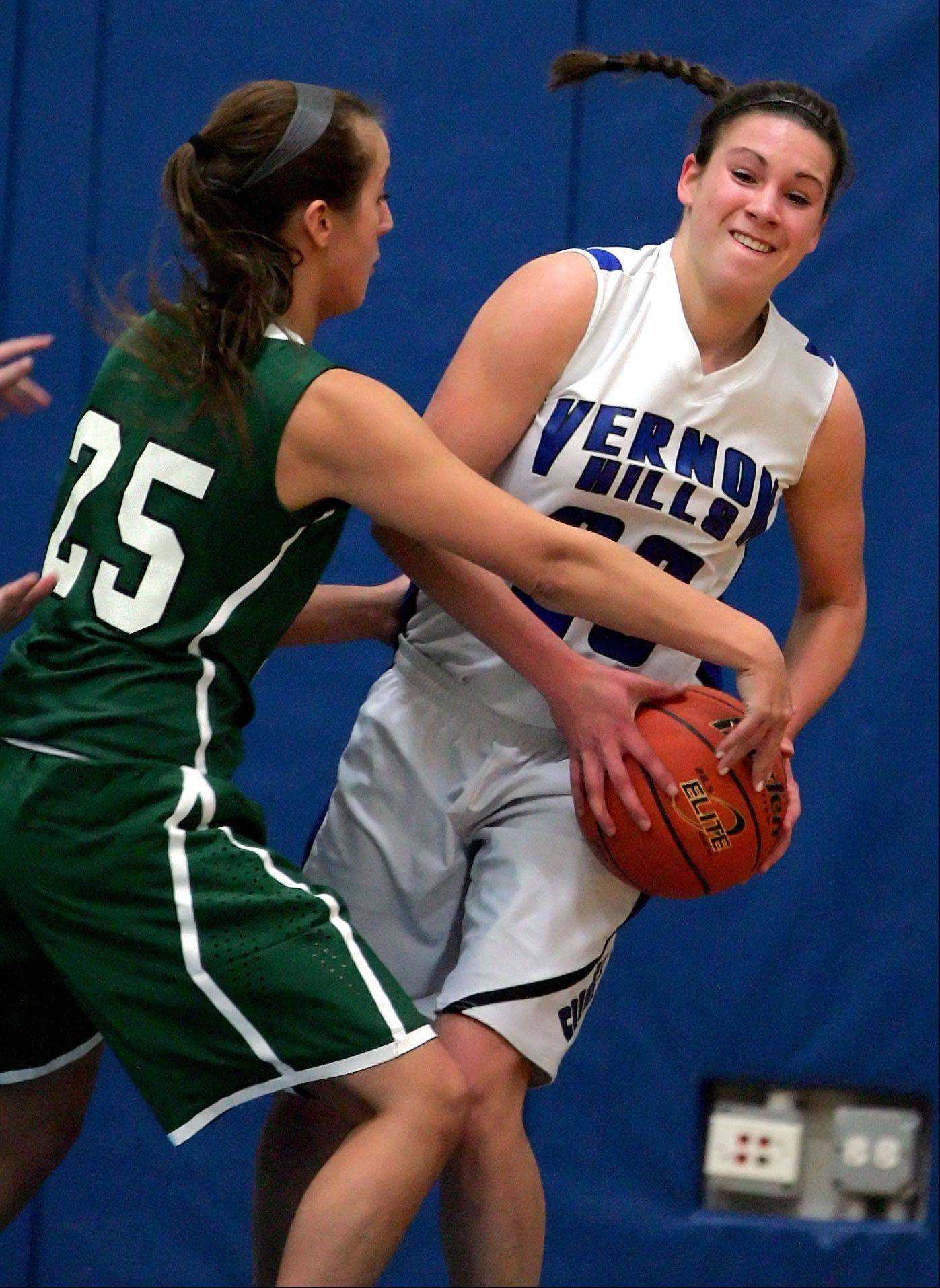 Vernon Hills' Brie Bahlmann, right, looks to pass as Grayslake Central's Taylor Peterson defends Tuesday night at Vernon Hills High School.