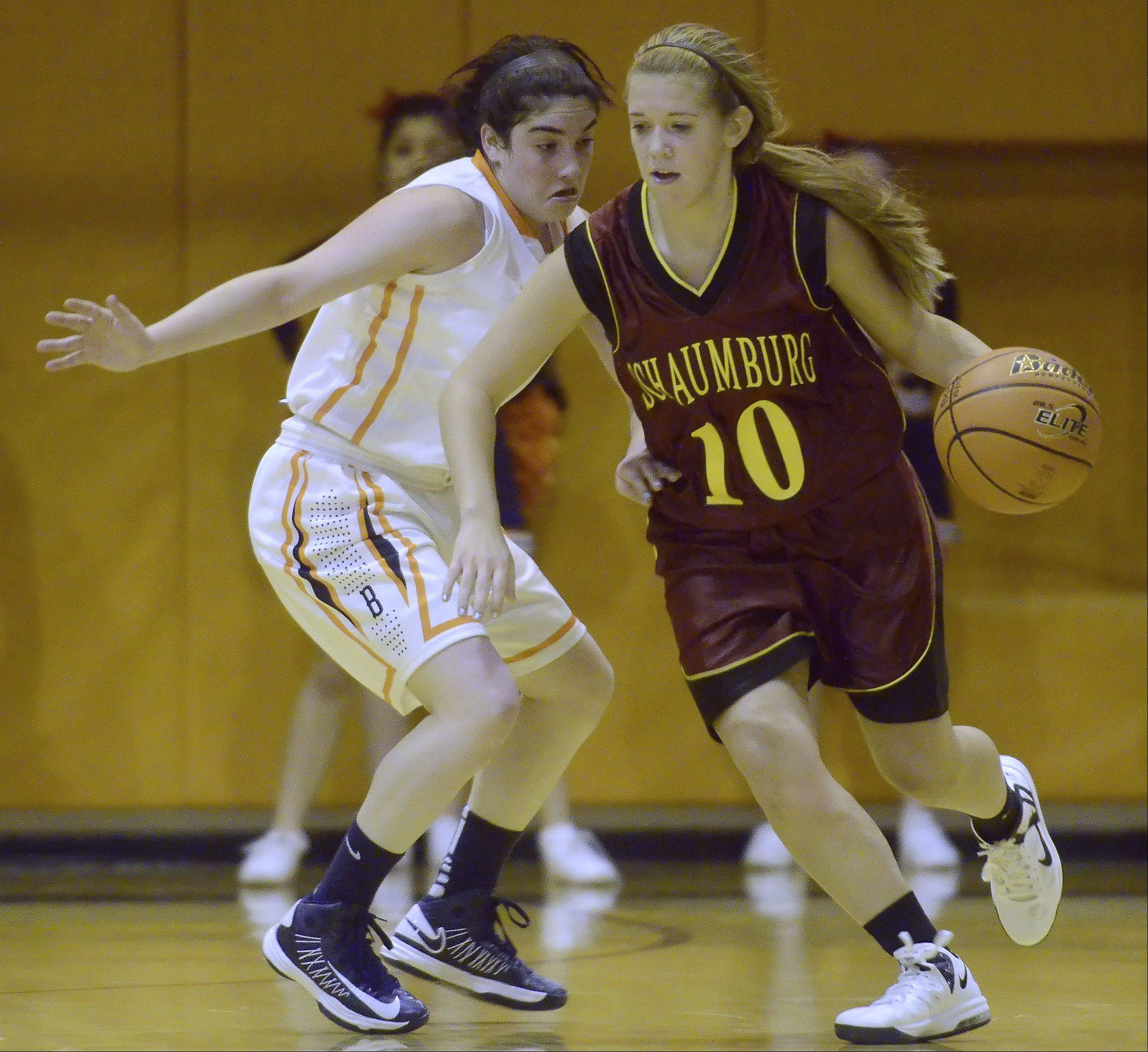 Schaumburg's Riley Williams drives around Buffalo Grove's Julie Jambrone during Tuesday's game.