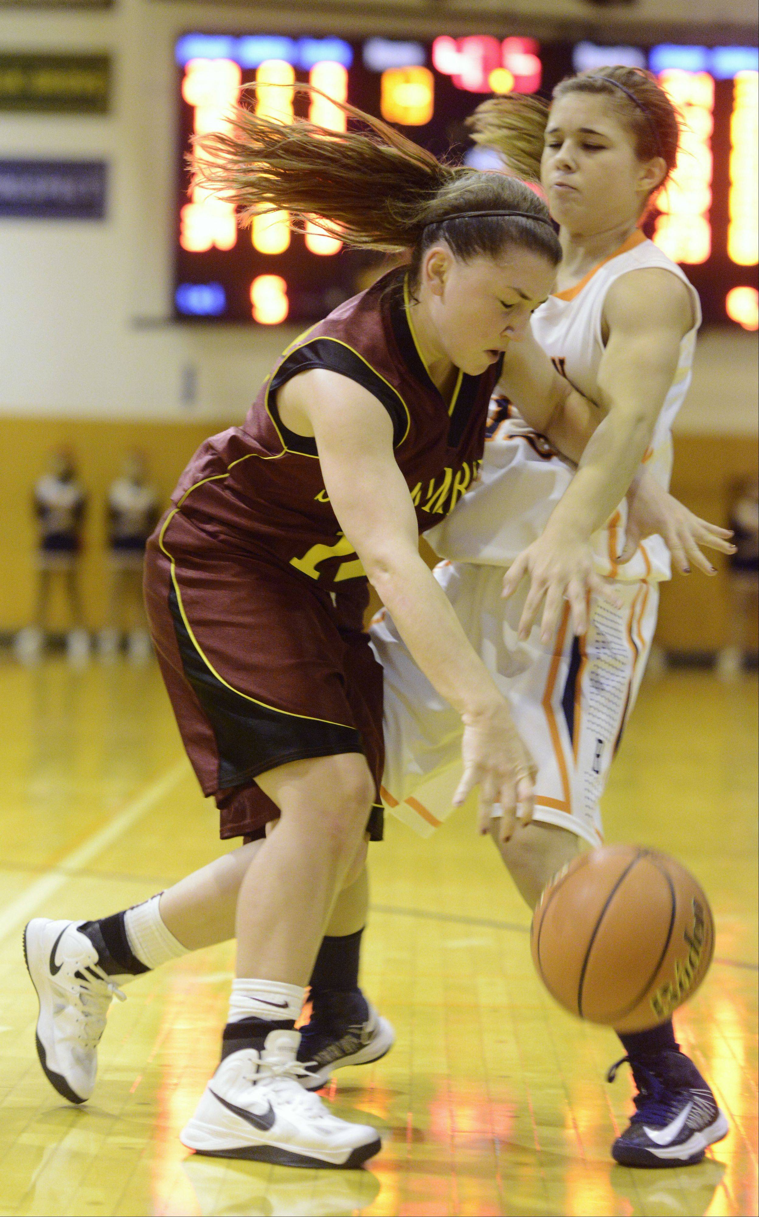 Schaumburg's Amanda Kelly, left, tries to get past Buffalo Grove's Kimberly Herzog during Tuesday's game.