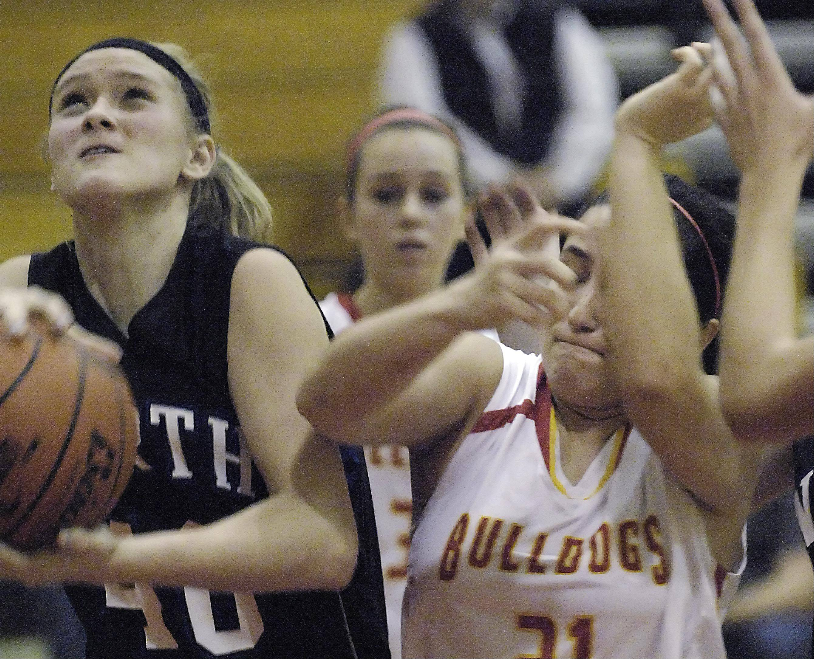 St. Charles North's Morgan Rosencrants gets the rebound against Batavia's Sami Villarreal.