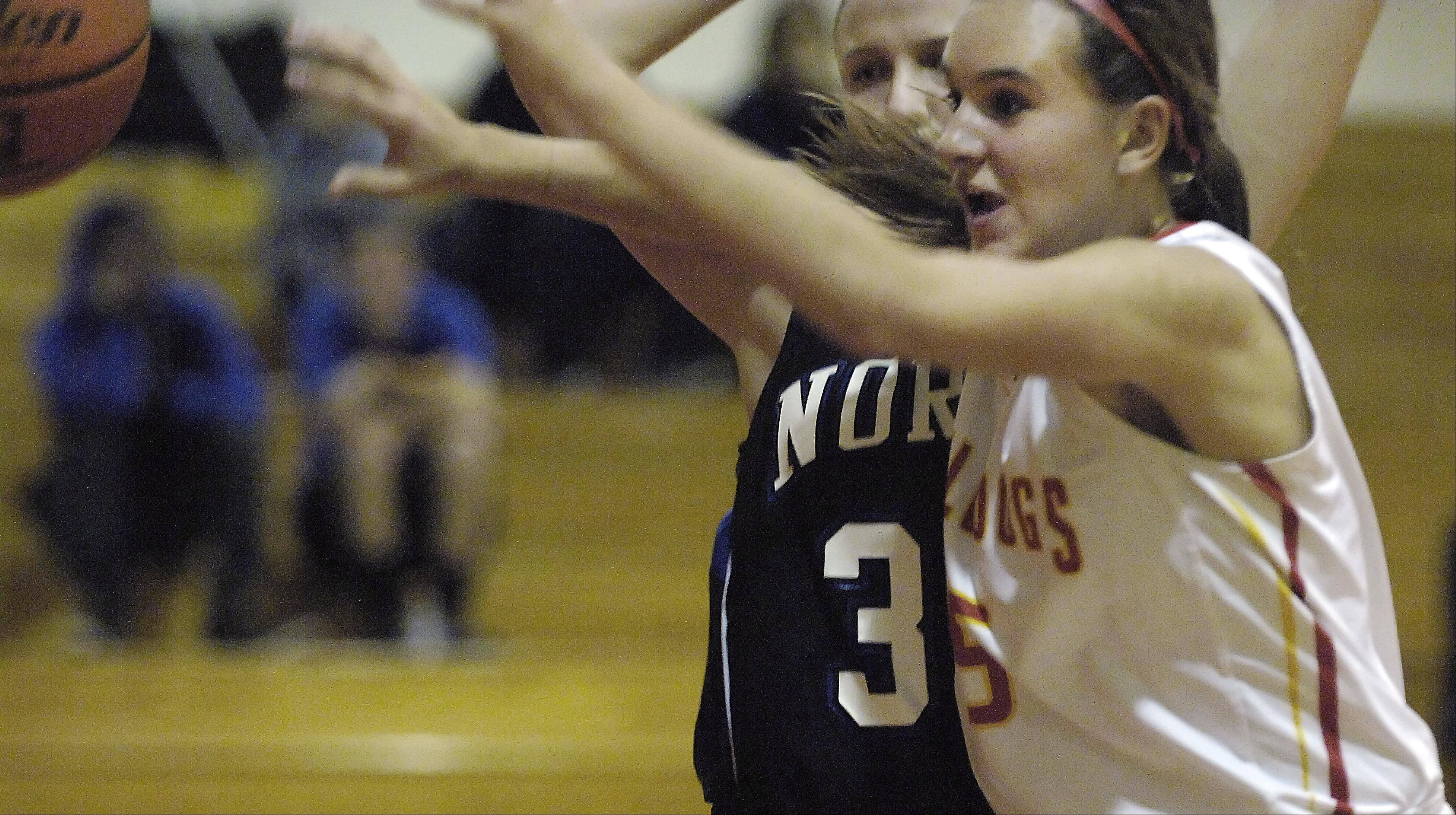 Batavia's Liza Fruendt steps in front of a pass to St. Charles North's Nicole Davidson.