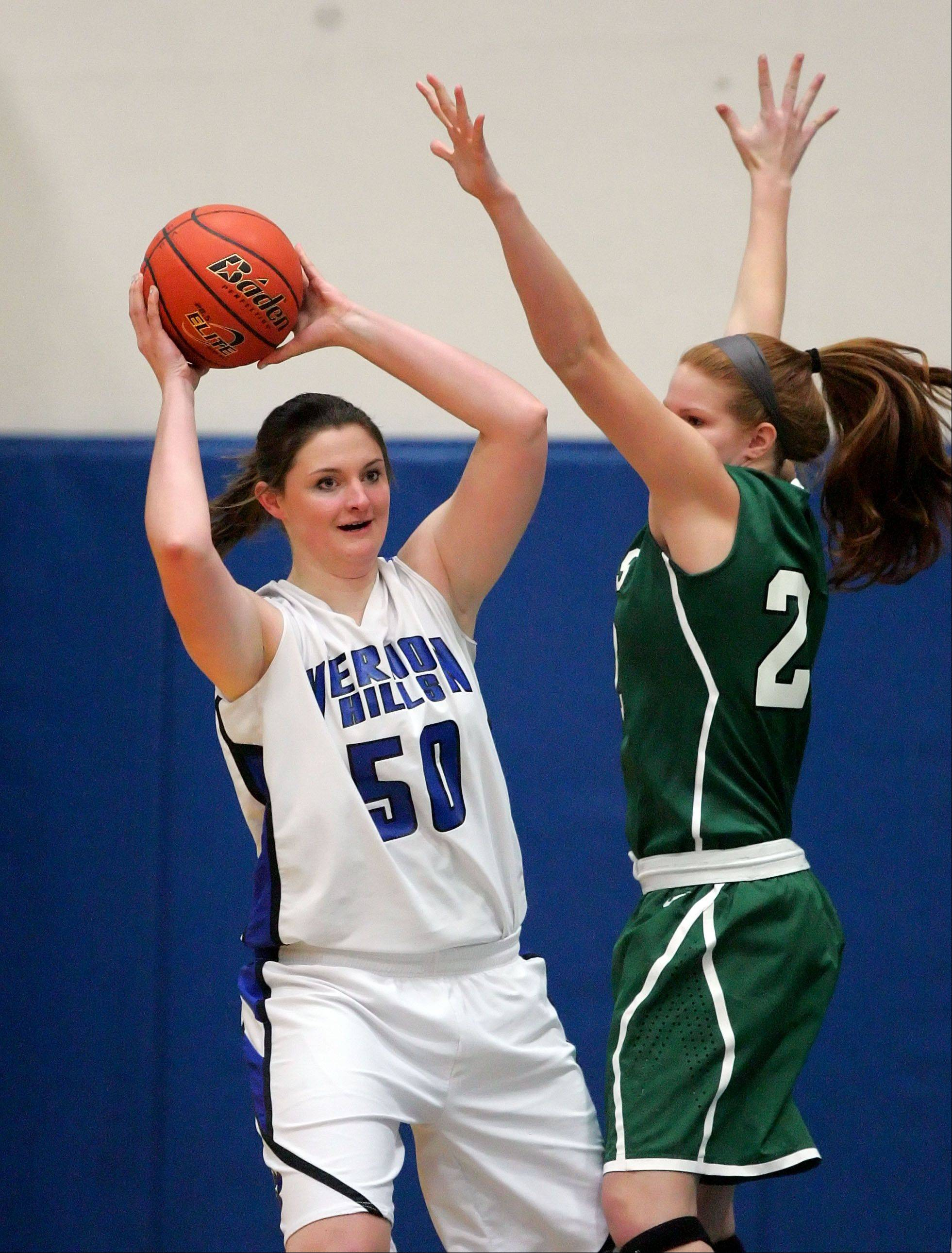 Vernon Hills' Meri Bennett-Swanson, left, looks to pass around Grayslake Central's Morgan Dahlstrom .