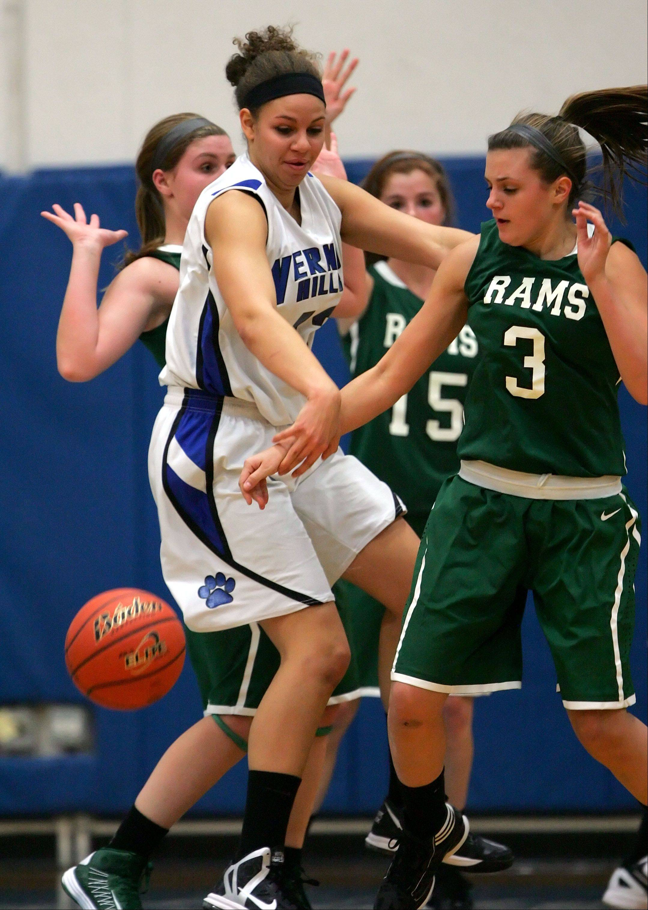 Vernon Hills' Lauren Webb and Grayslake Central's Savannah Mudd batle for a loose ball.