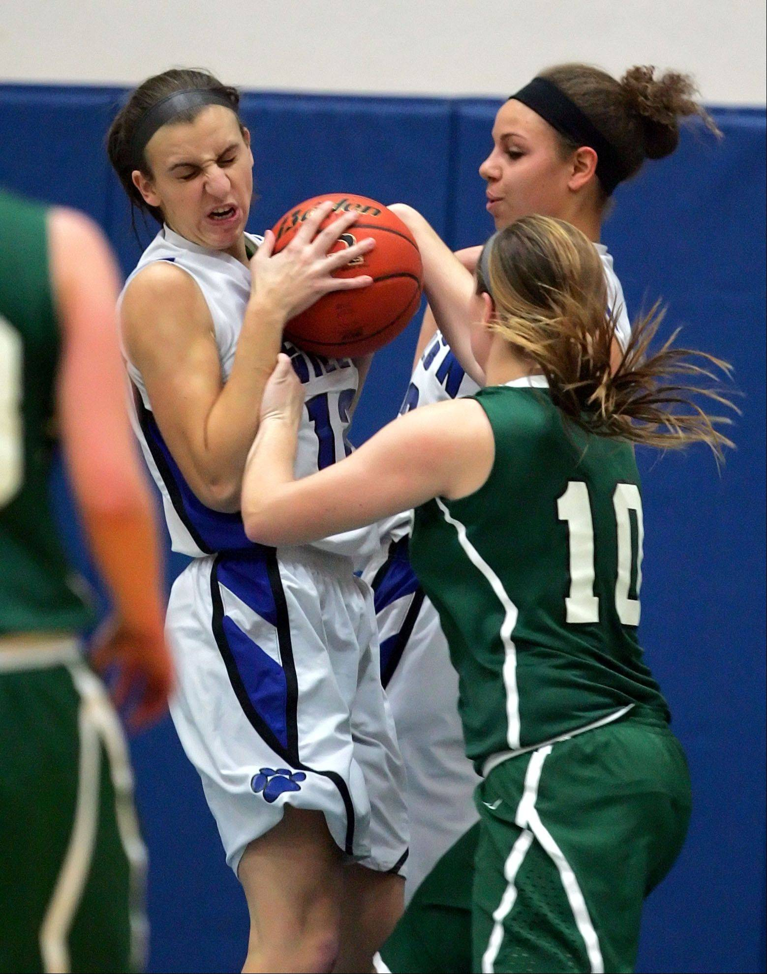 Vernon Hills' Alina Lehocky , left, and Lauren Webb battle for a rebound with Grayslake Central's Maddy Miller.