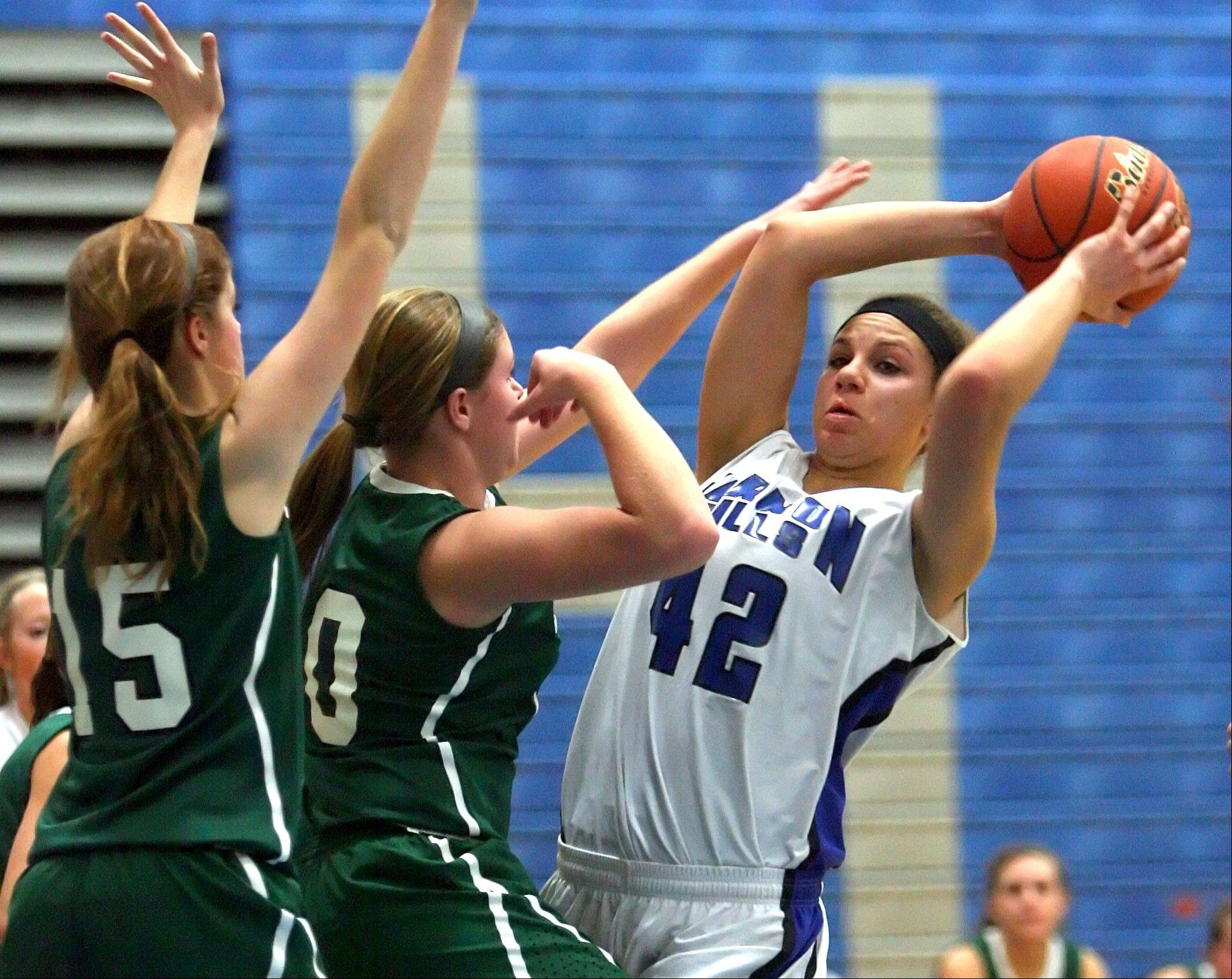 Vernon Hills' Lauren Webb, right, looks to pass with Grayslake Central's Lauren Spalding and Maddy Miller defending.