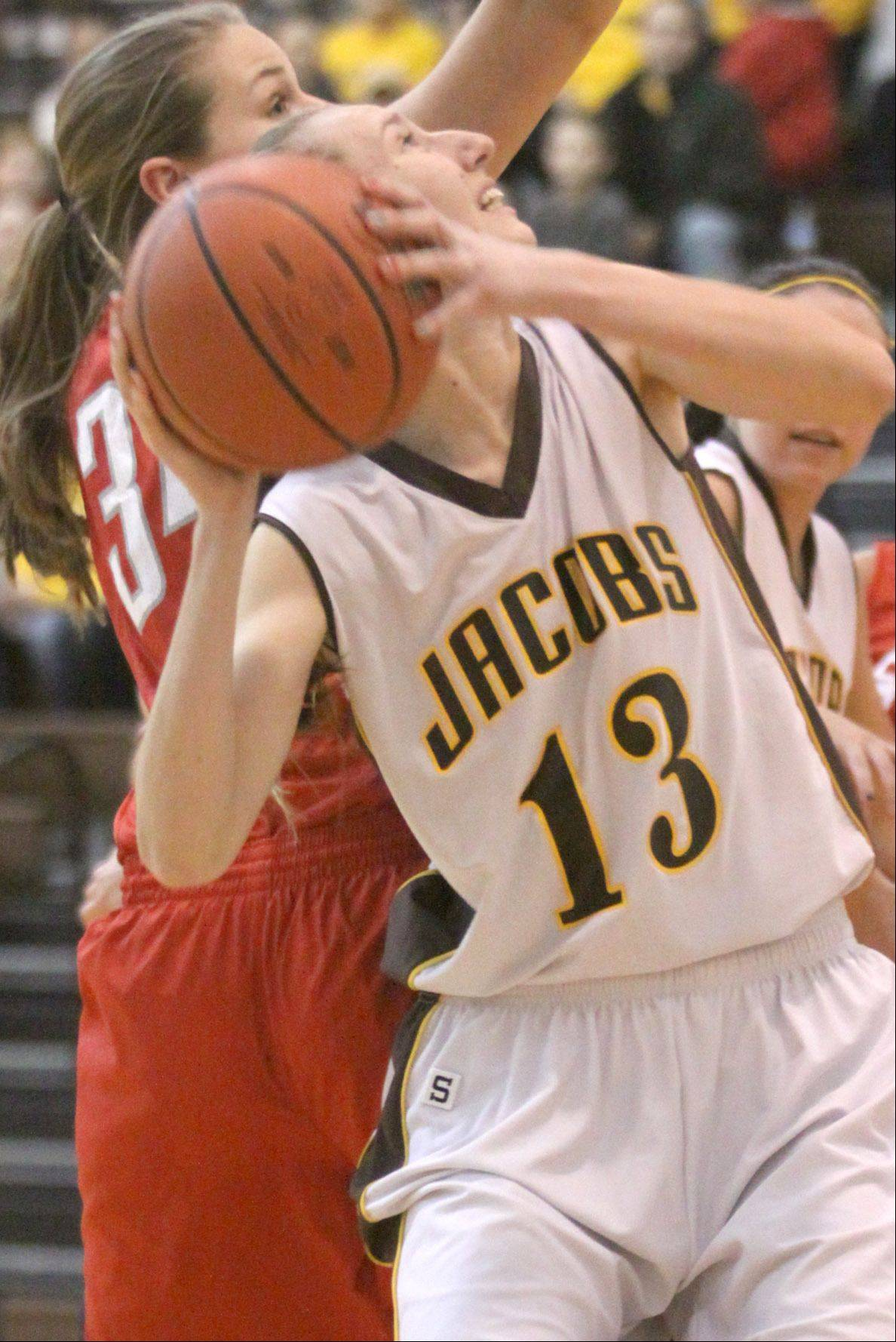 Jacobs' Victoria Tamburrino takes a shot against South Elgin during a varsity basketball game at Algonquin on Tuesday night.