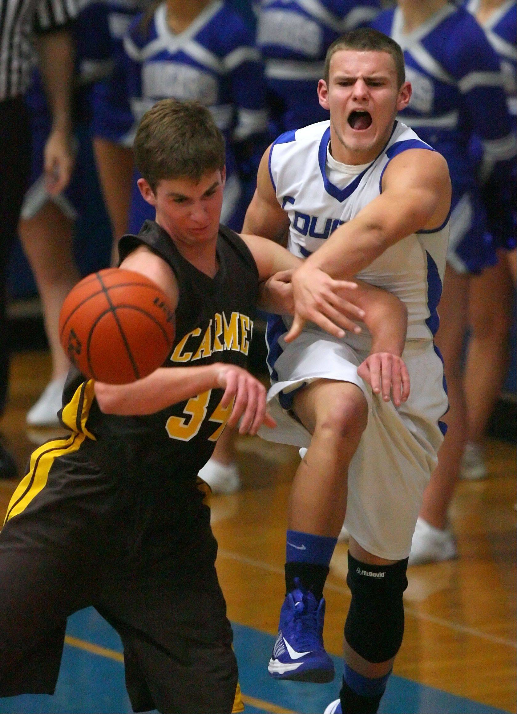 Carmel's Cullen Barr, left, and Vernon Hills' TJ Flis battle for a rebound.