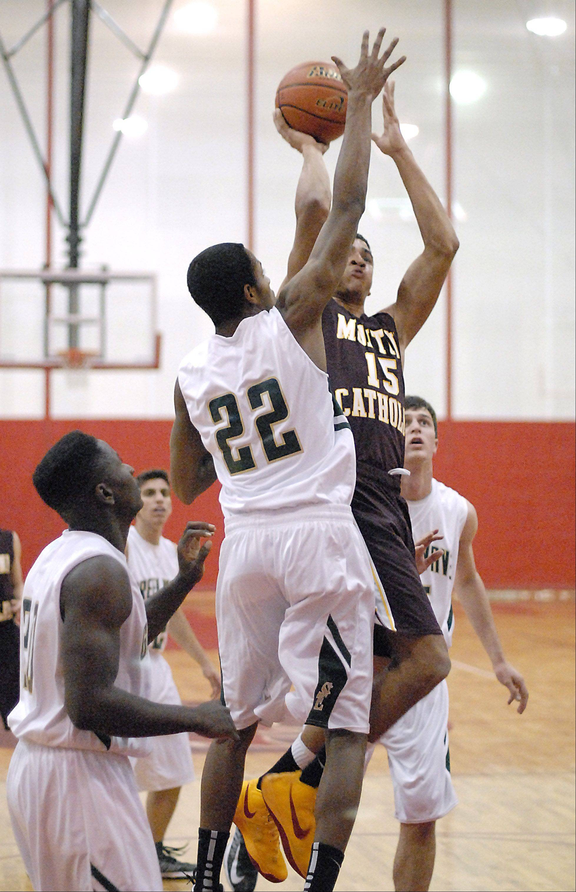 St. Edward's Adrian Ponce attempts to block a shot by Montini's Simmie Cobbs.