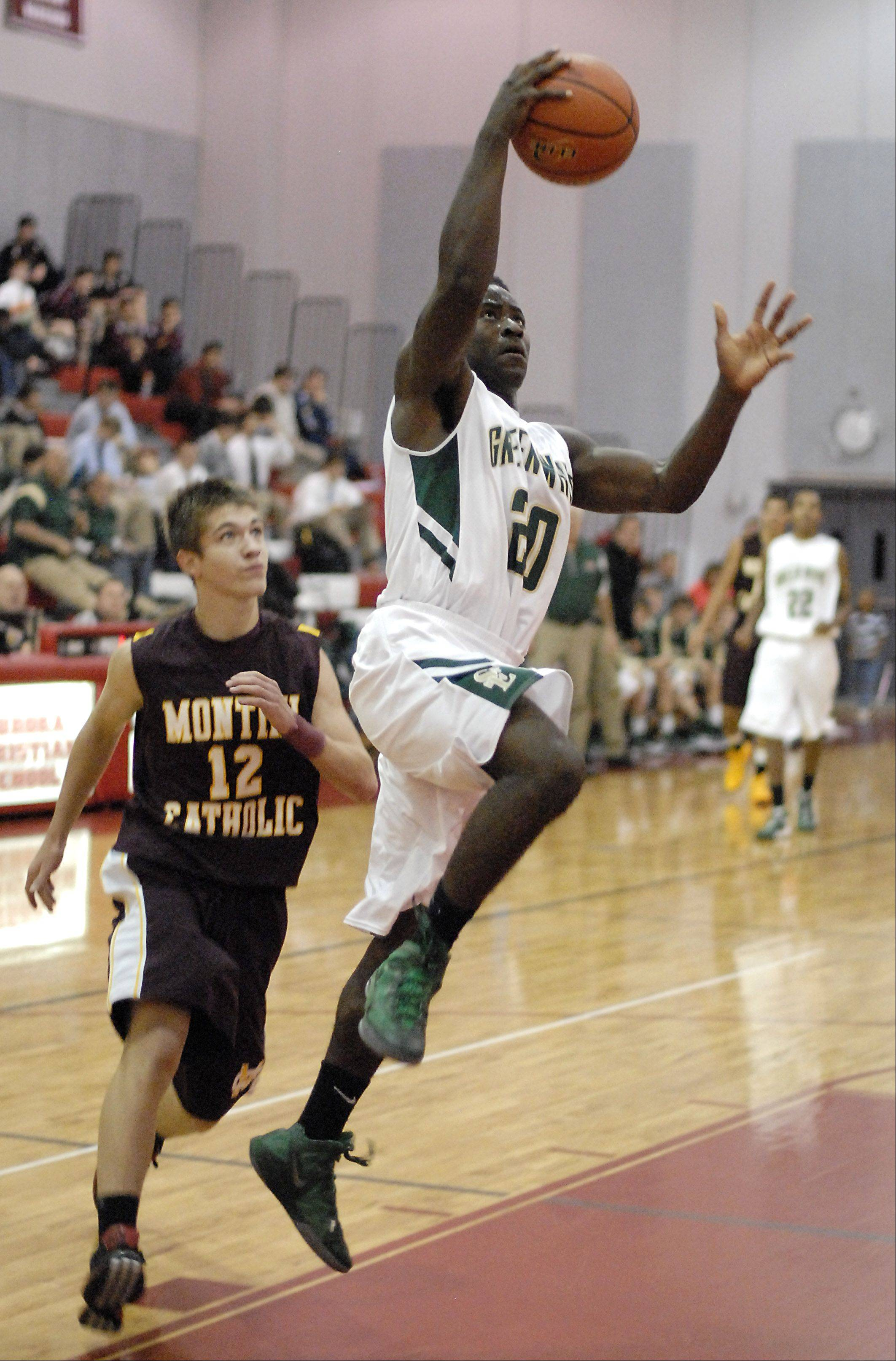 St. Edward's Davontae Elam goes up for a shot past Montini's Jack Brady.