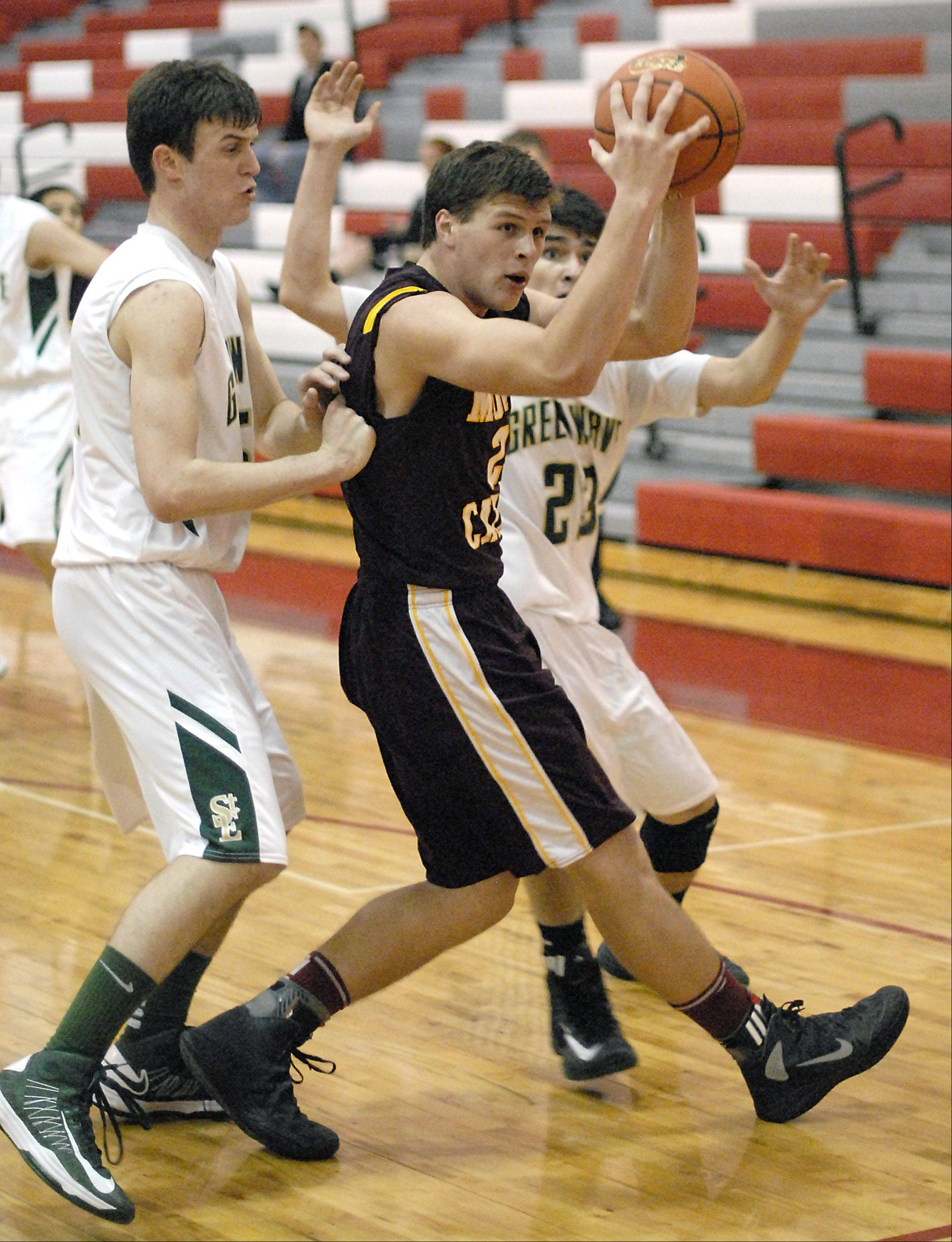 St. Edward's Nick Duffy and Danny Favela surround Montini's Matt Brachmann.
