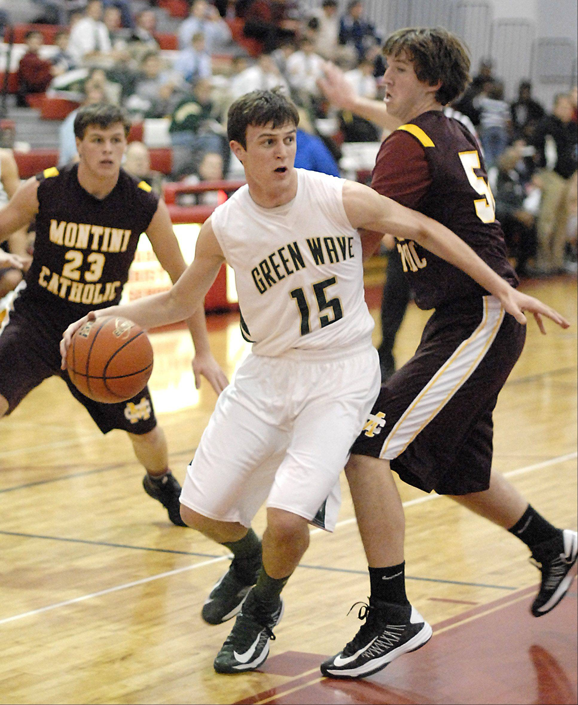 St. Edward's Nick Duffy pivots around a block by Montini's Brian Orr in the second quarter on Wednesday.