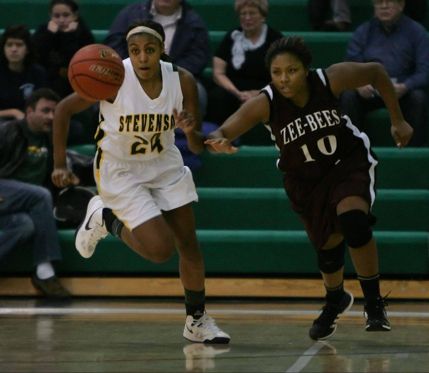 Stevenson forward Taylor Buford steals the ball away from Zion-Benton forward Keonnia Gentry in the first quarter at Stevenson on Thursday.