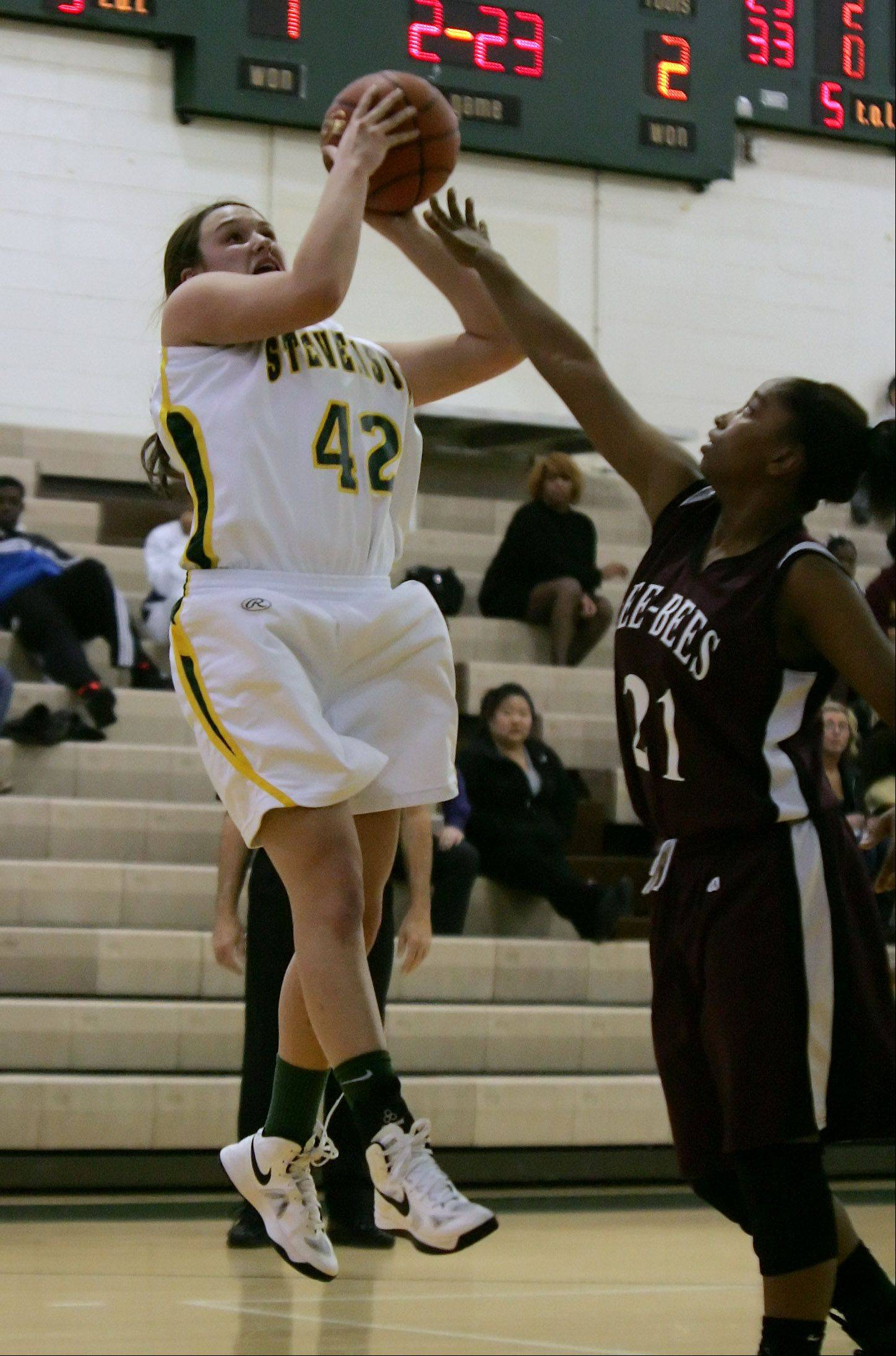 Stevenson center Alex Elzinga shoots over Zion-Benton forward Samantha Rodriguez at Stevenson on Thursday.