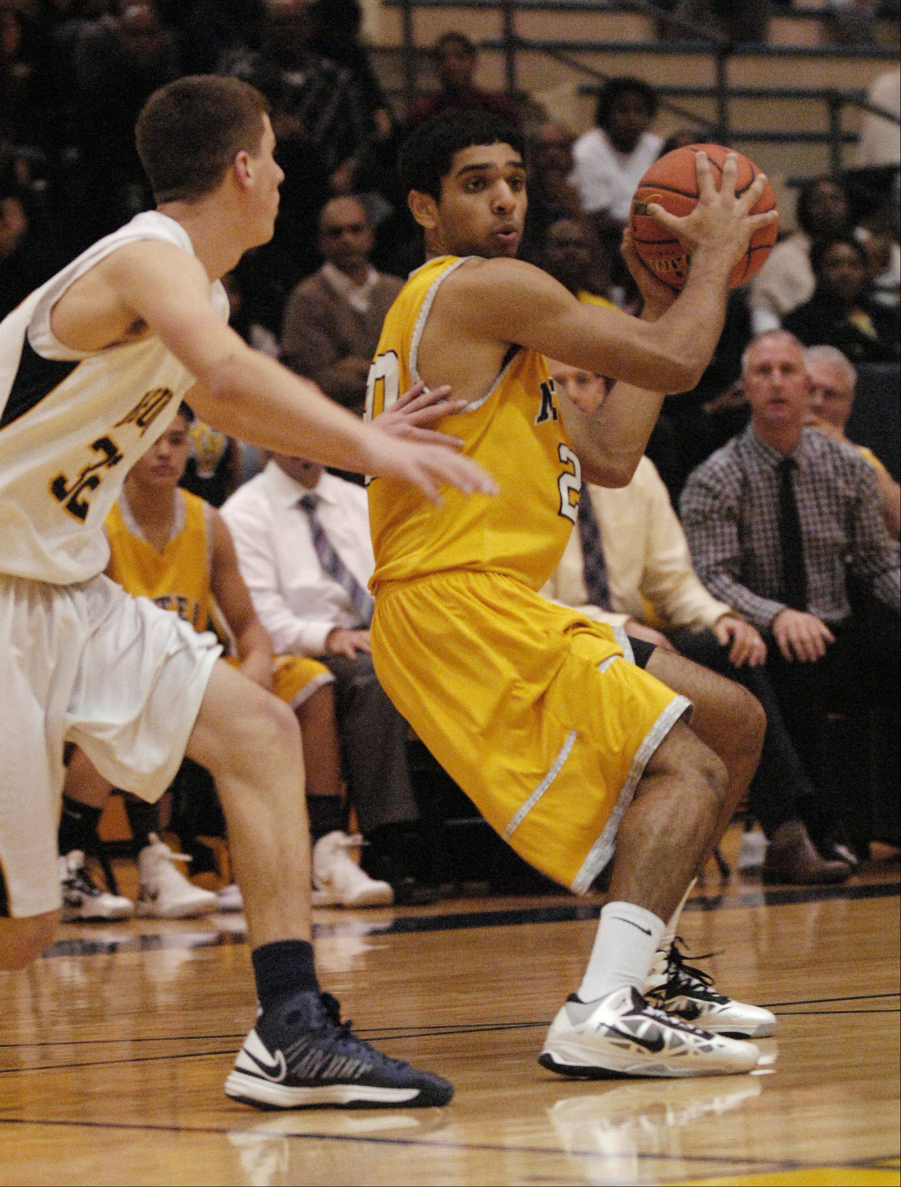 Vin Patel of Metea Valley works to get past Connor Raridon of Neuqua Valley.