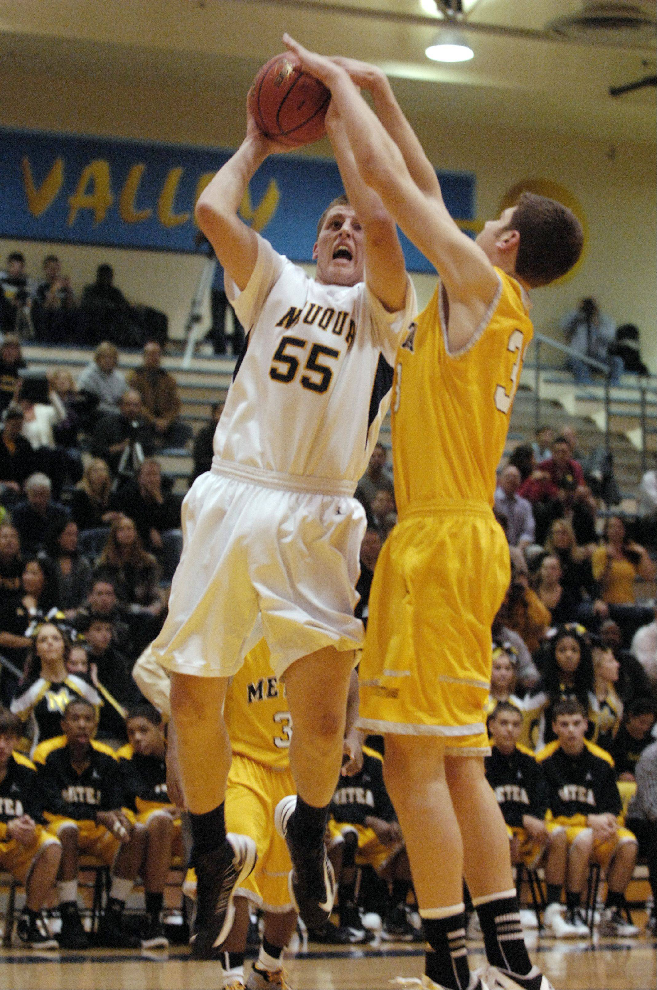 Pat Kenny of Neuqua Valley works at getting around Hayden Barnard of Metea Valley.