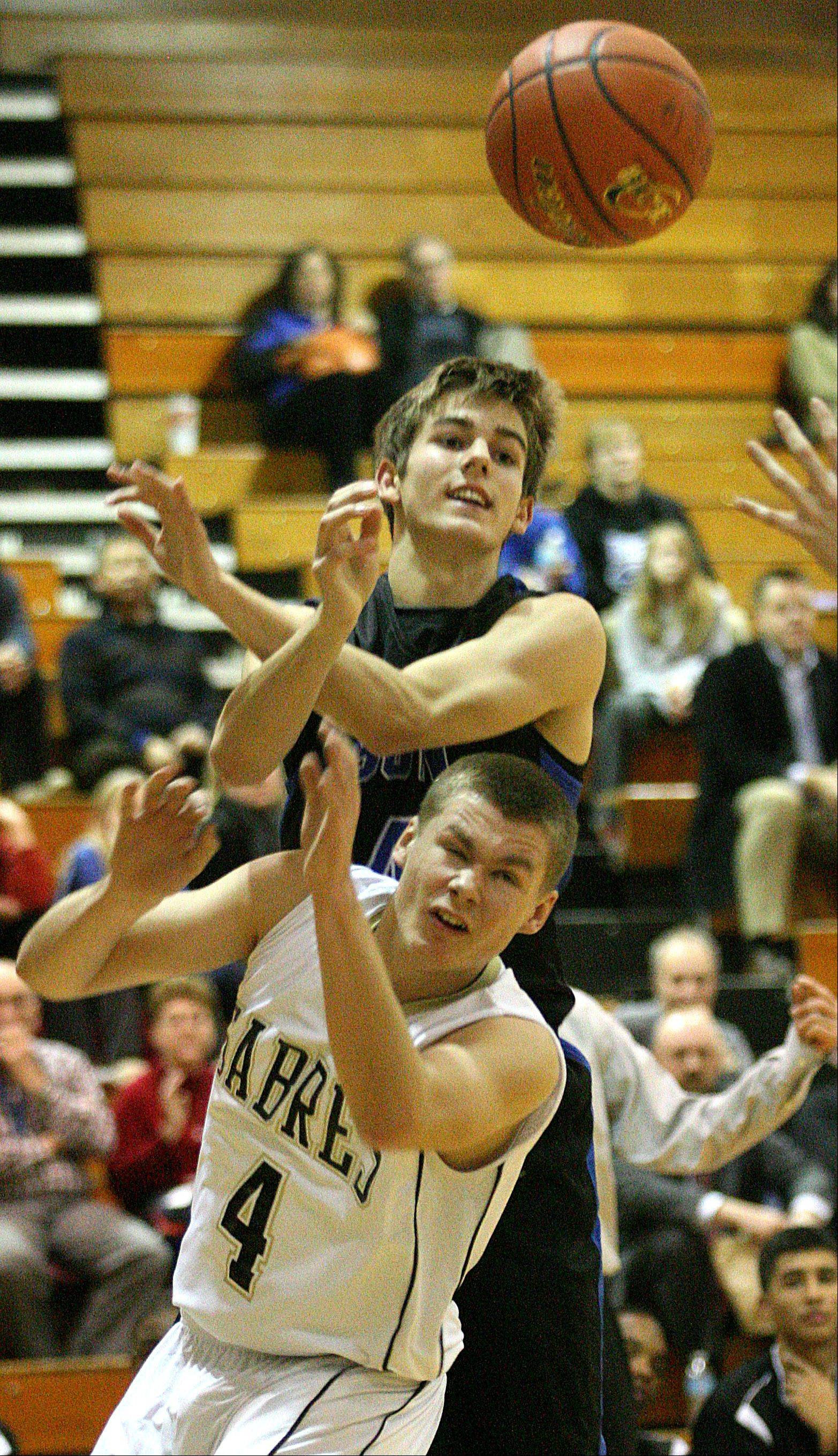 Streamwood's Jacob Siewert, bottom, and St Charles North's Jake Ludwig look for the ball.