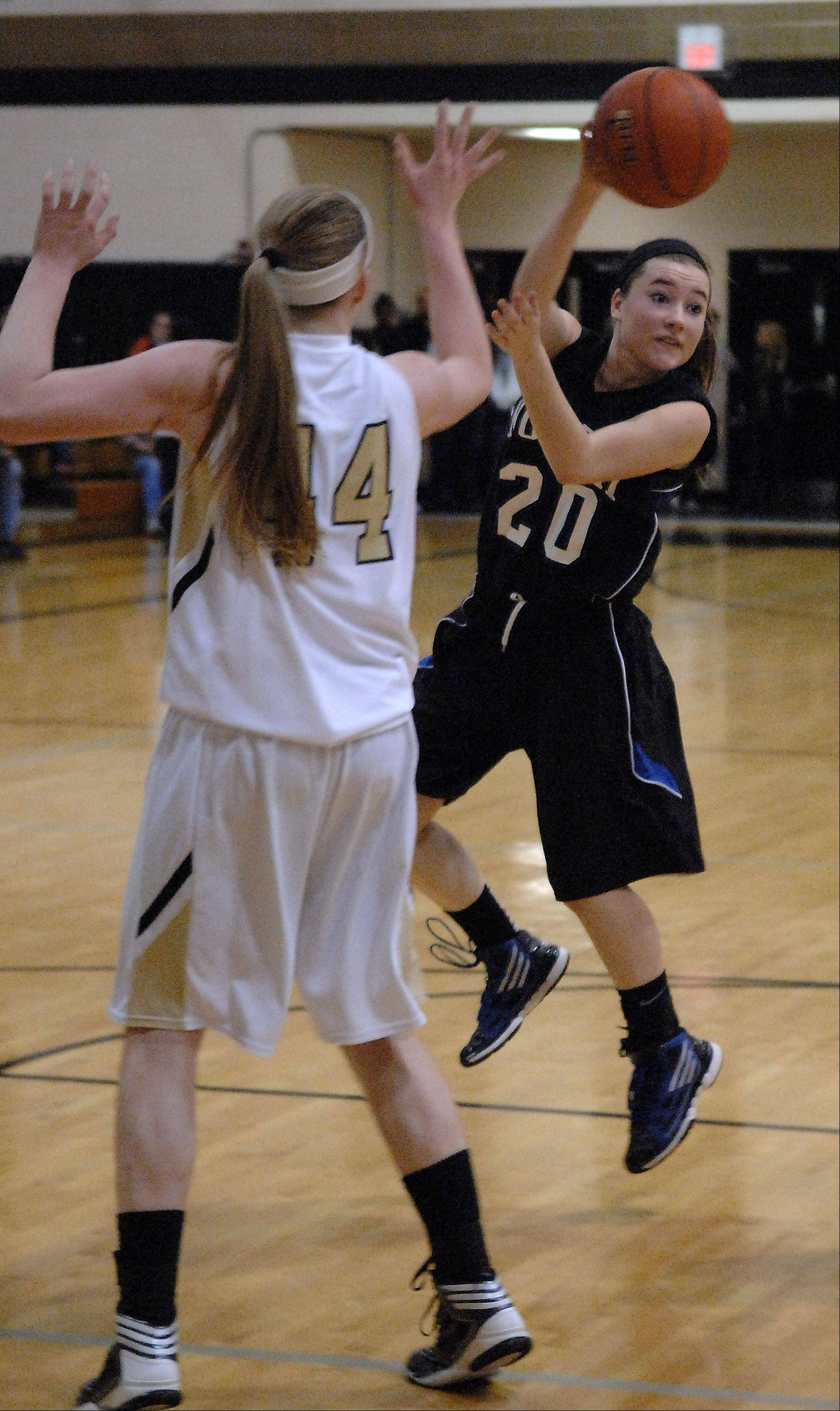 St. Charles North's Sam Novak drives and dishes against Streamwood during Friday's game at Streamwood.