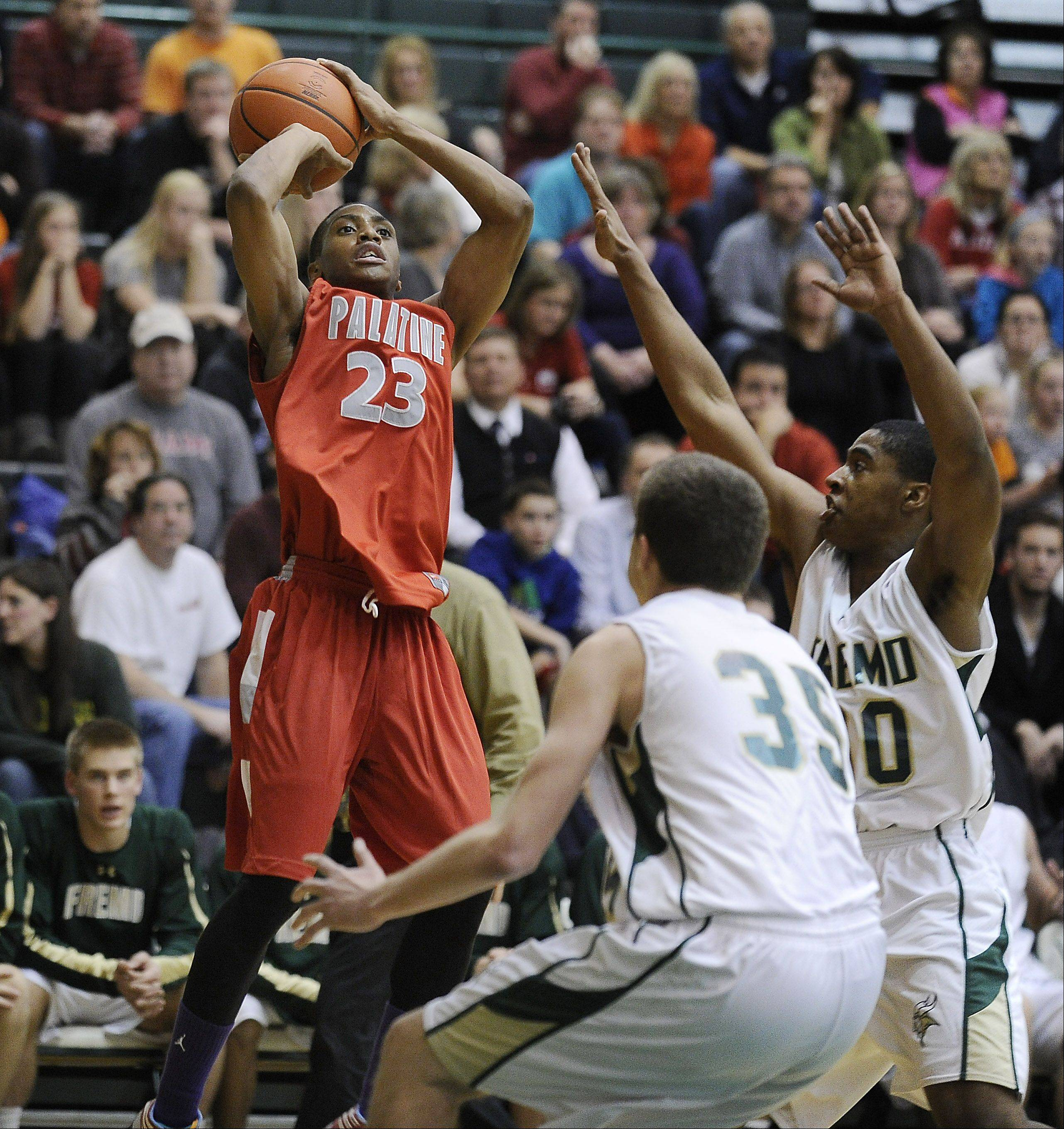 Palatine's Roosevelt Smart does a fade-away jump shot for a basket while under pressure against Fremd.