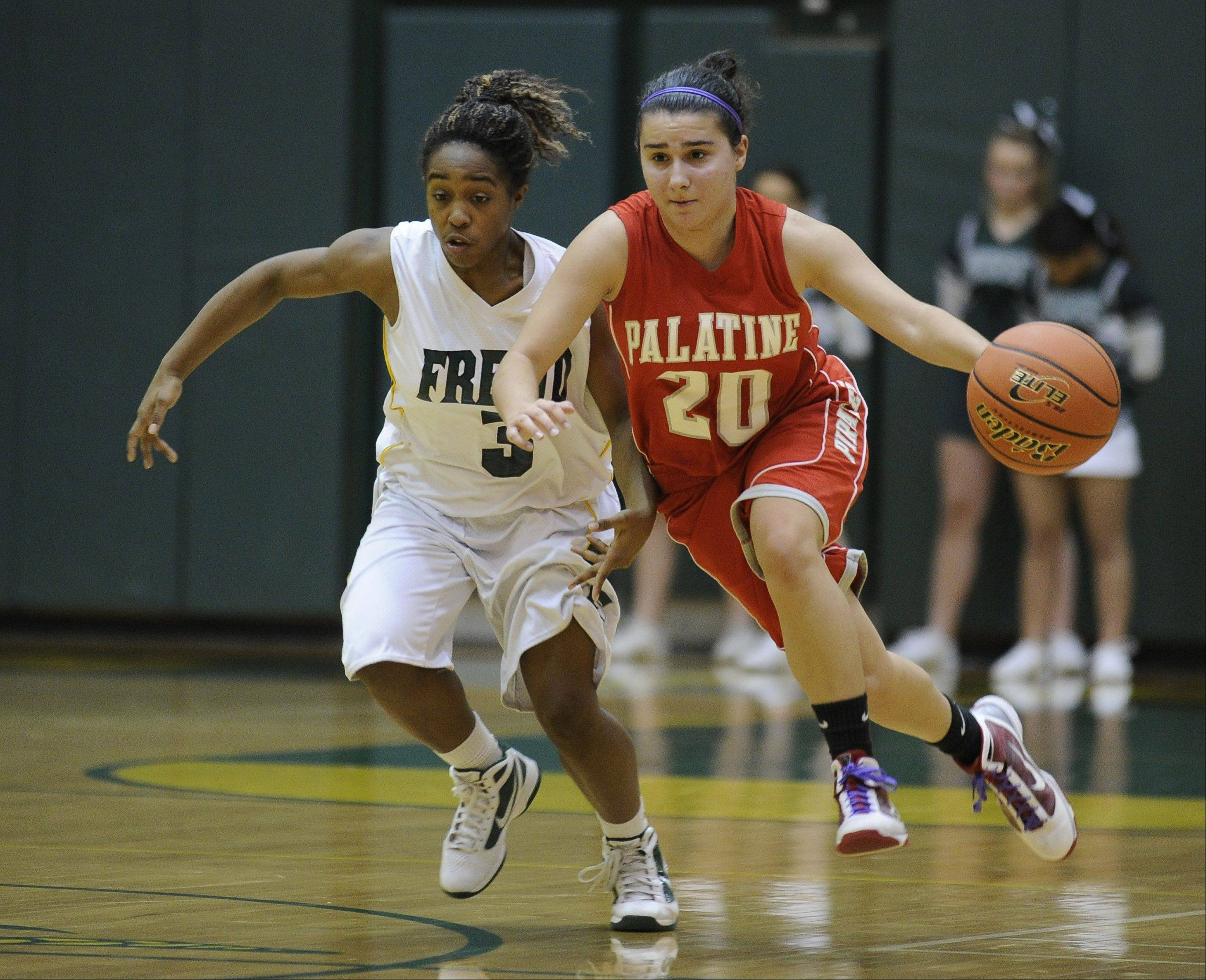 Palatine's Nia Pappas heads down court under pressure from Fremd's Brianna Lewis in the second half.