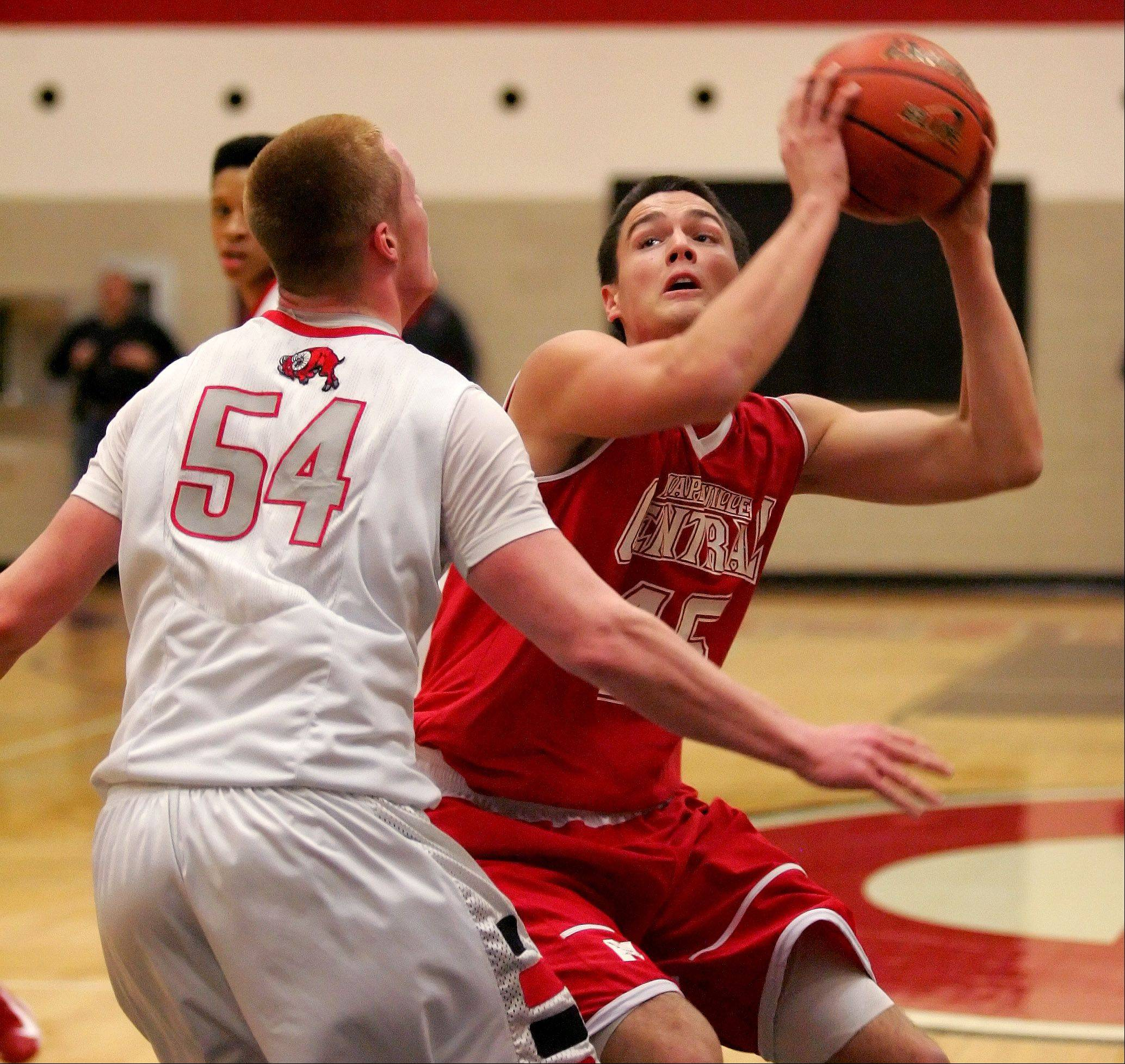 Nick Czarnowski of Naperville Central, right, looks for room to shoot around Brandon Havenga of Glenbard East.