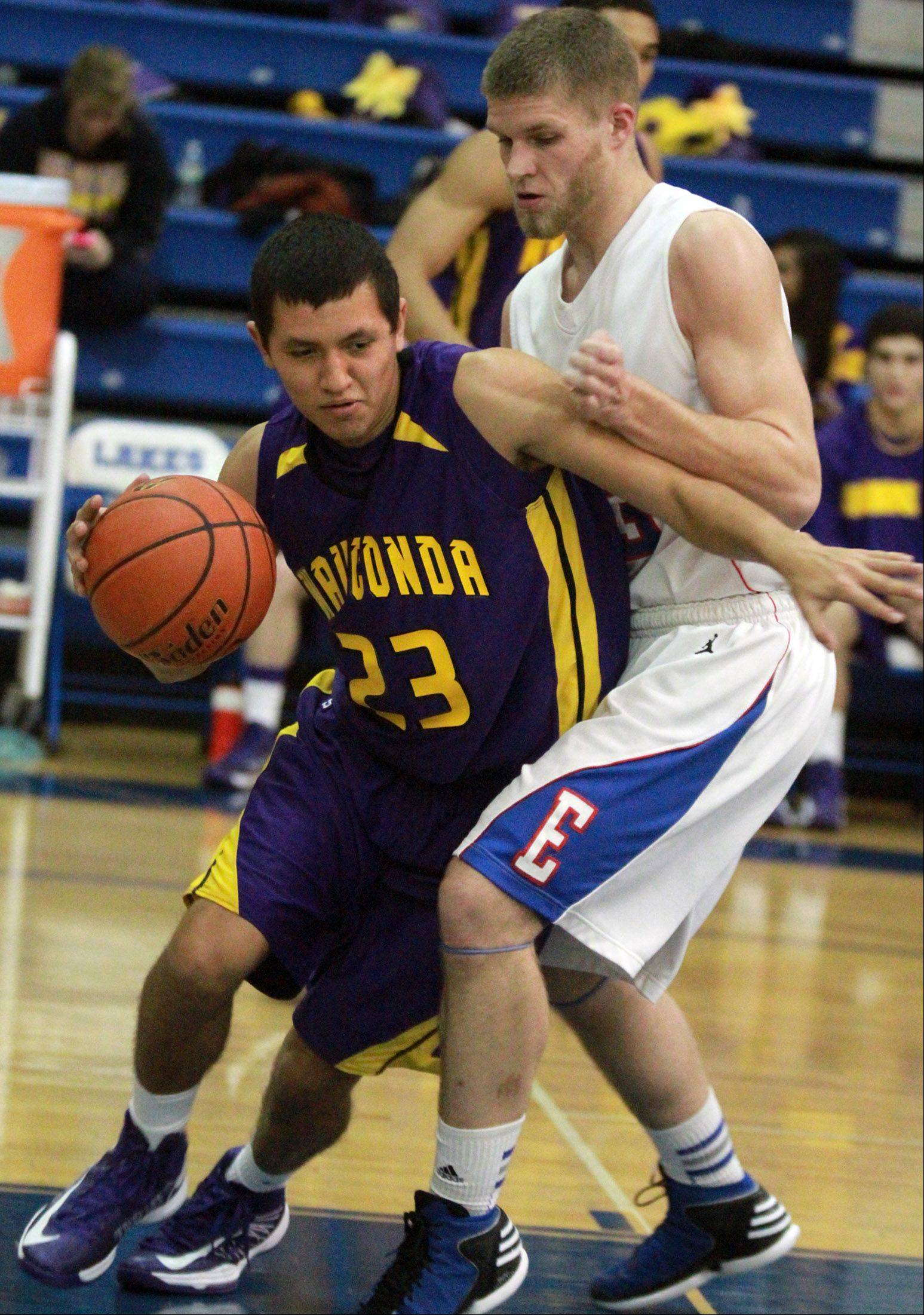 Wauconda's Kodey Thomas tries to turn the corner against Lakes defender Jake Kohler .