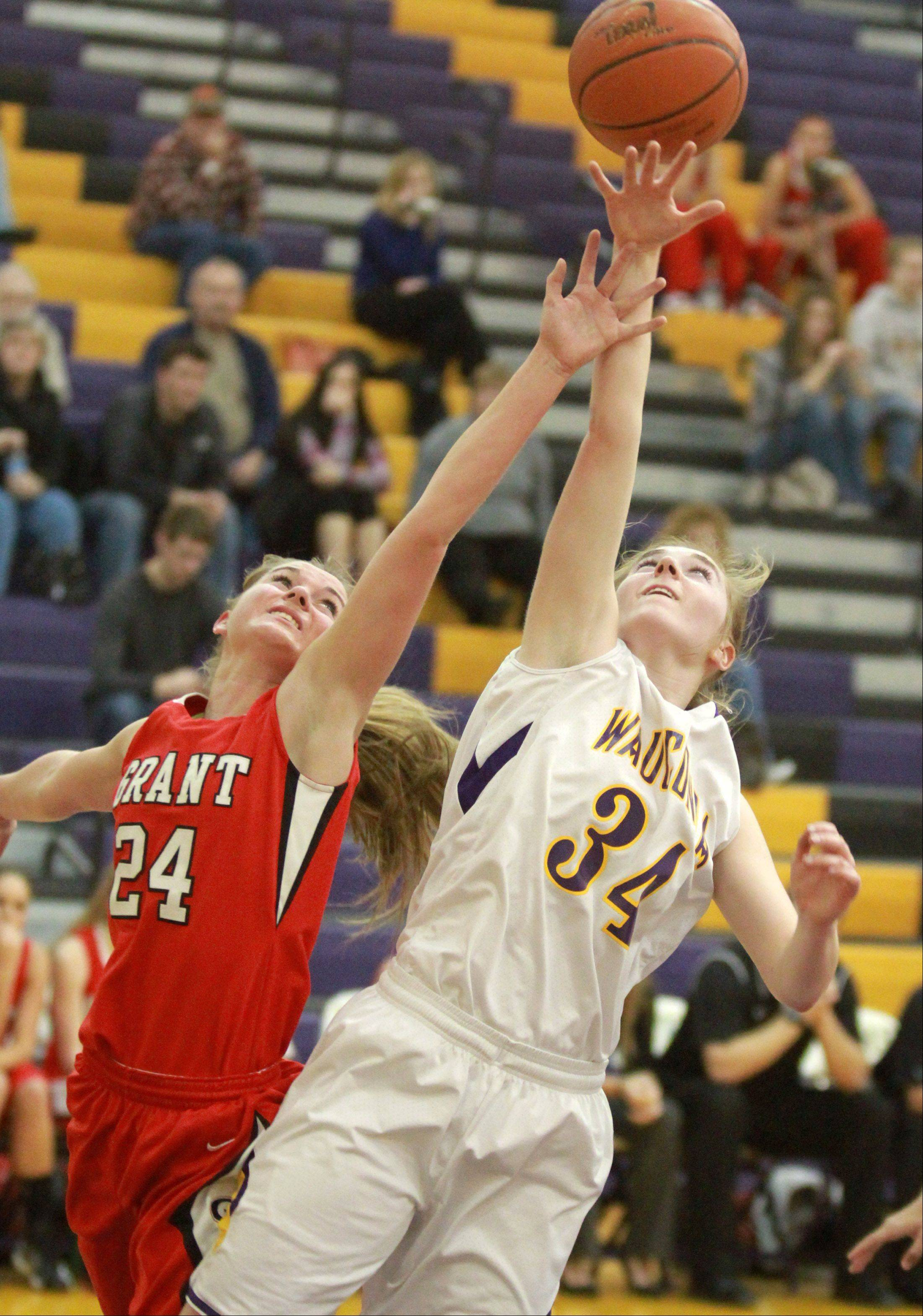 Wauconda's Jessie Wood fights for an offensive rebound against Grant defender Kaylie Kanzler at Wauconda on Saturday.