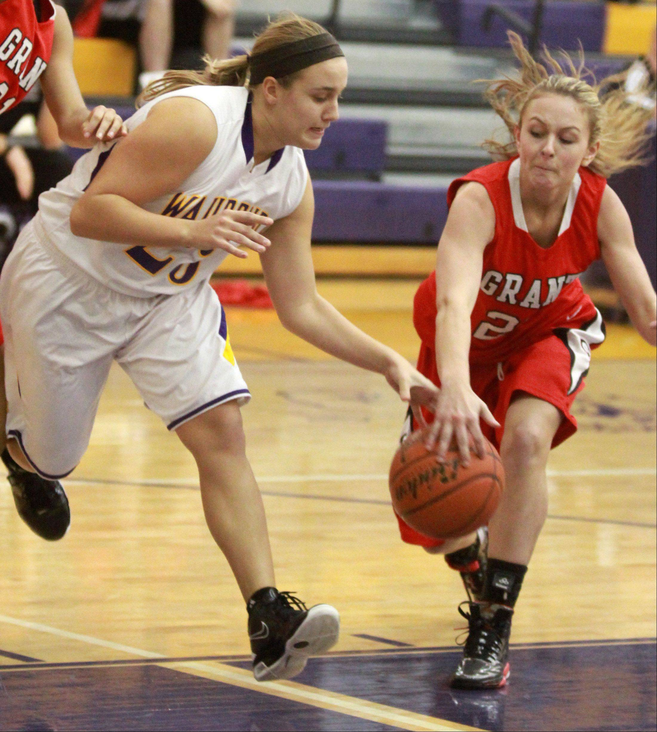 Wauconda's Becca Michelau, left, fights for a loose ball with Grant's Michelle Filip at Wauconda on Saturday.