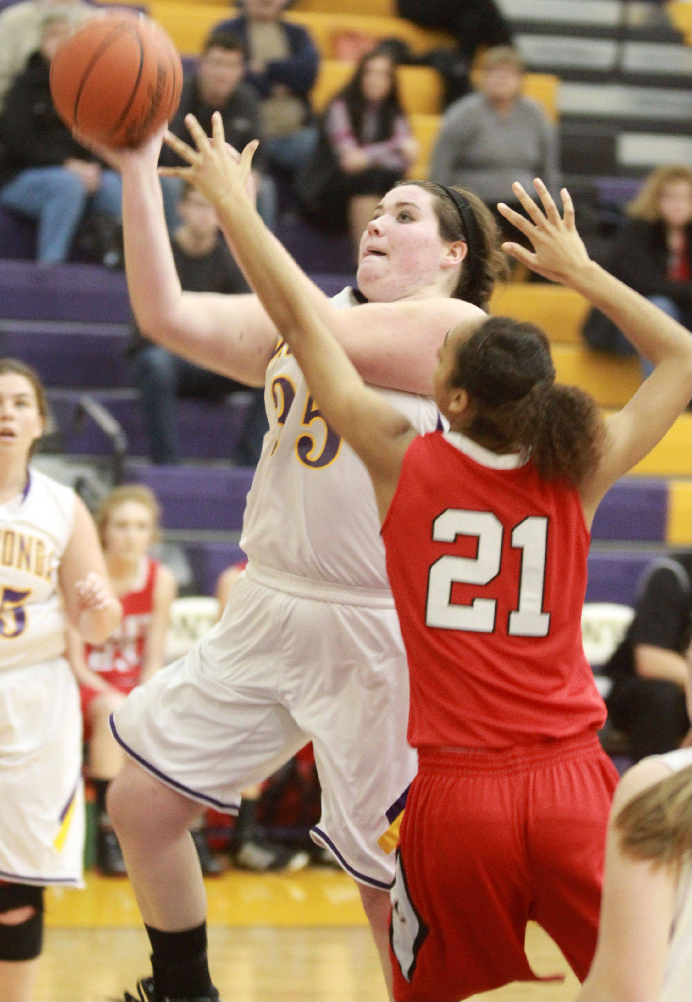 Wauconda's Dani Sturm shoots over Grant defender Julia Sangster at Wauconda on Saturday.
