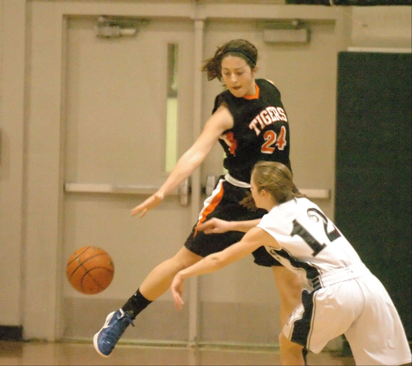 Maggie Dansdill blocks a pass from Mae Elizabeth Gimre of West Chicago during the Wheaton Warrenville South at West Chicago girls basketball game Saturday.