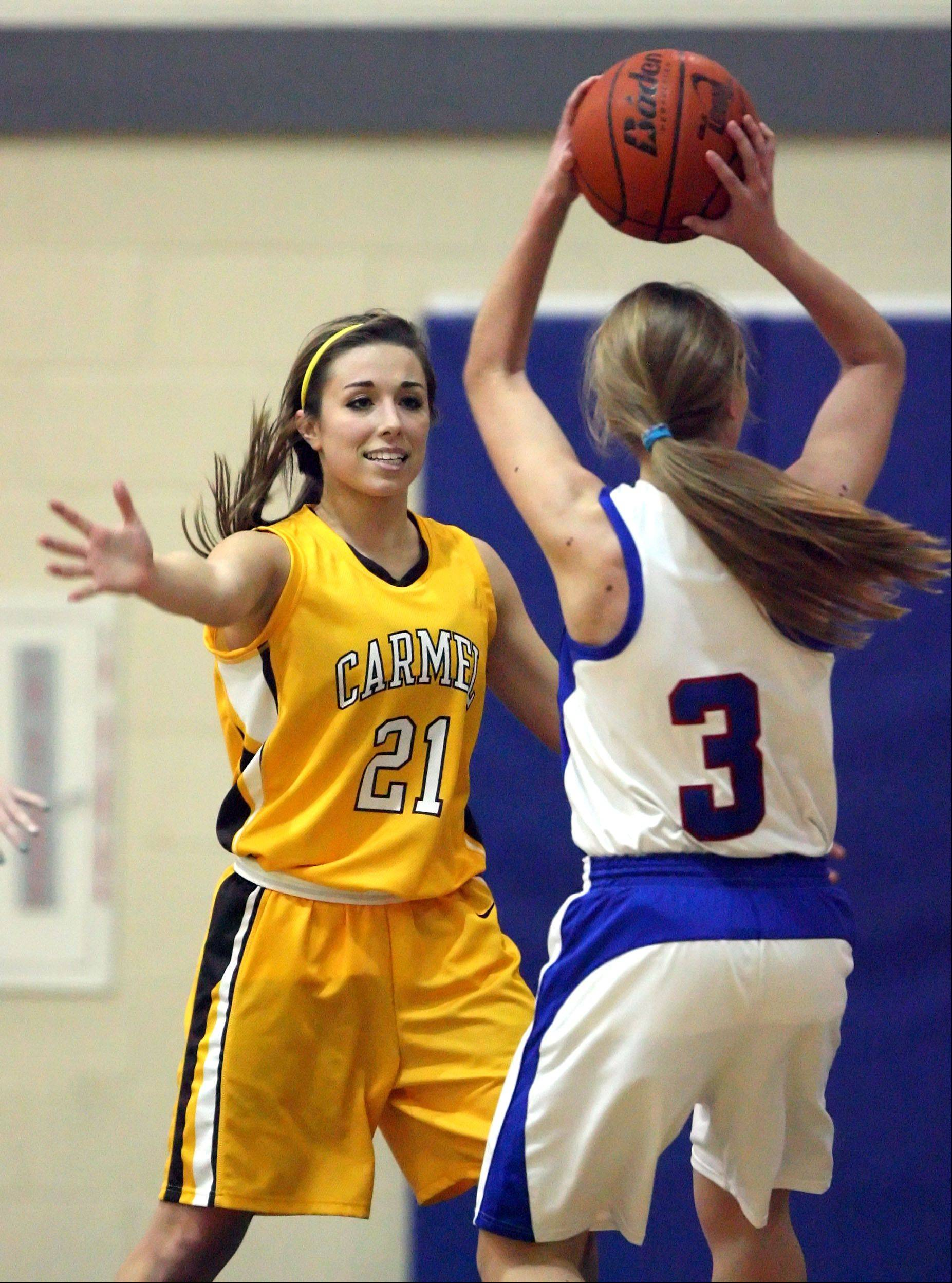 Carmel's Nicole Bitter, left, defends against Lakes' Heather Hurlbut on Monday night at Lakes.