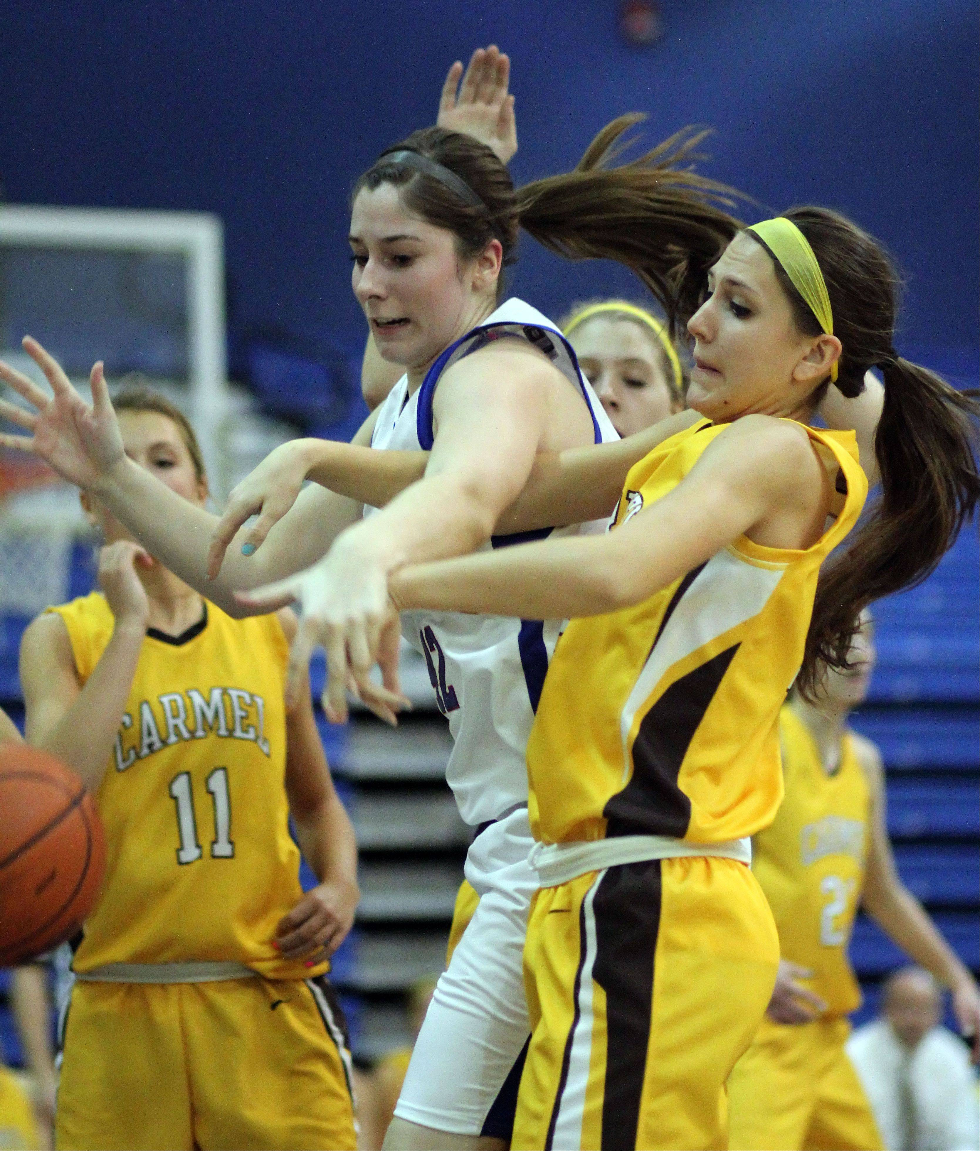 Lakes' Therese McMahon, left, and Carmel's Paige Gauthier battle for a rebound on Monday night at Lakes.