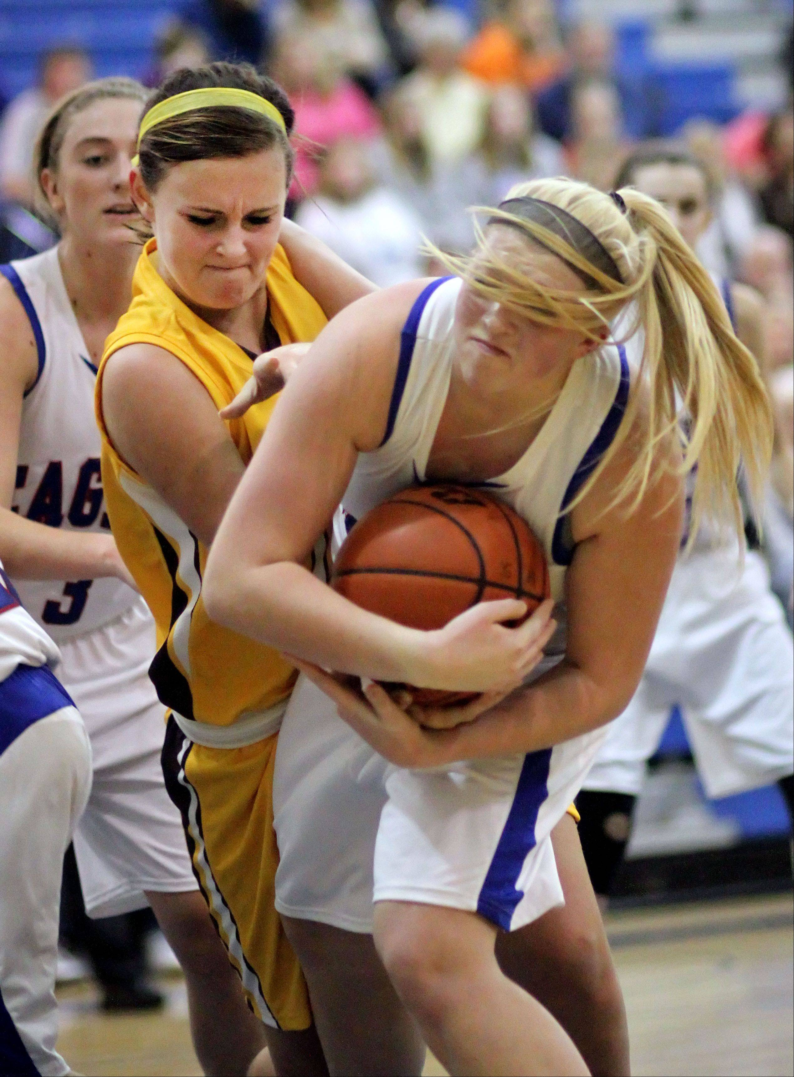 Carmel's Cassidy Kloss, left, and Lakes' Dayna Olson battle for a loose ball Monday night at Lakes.