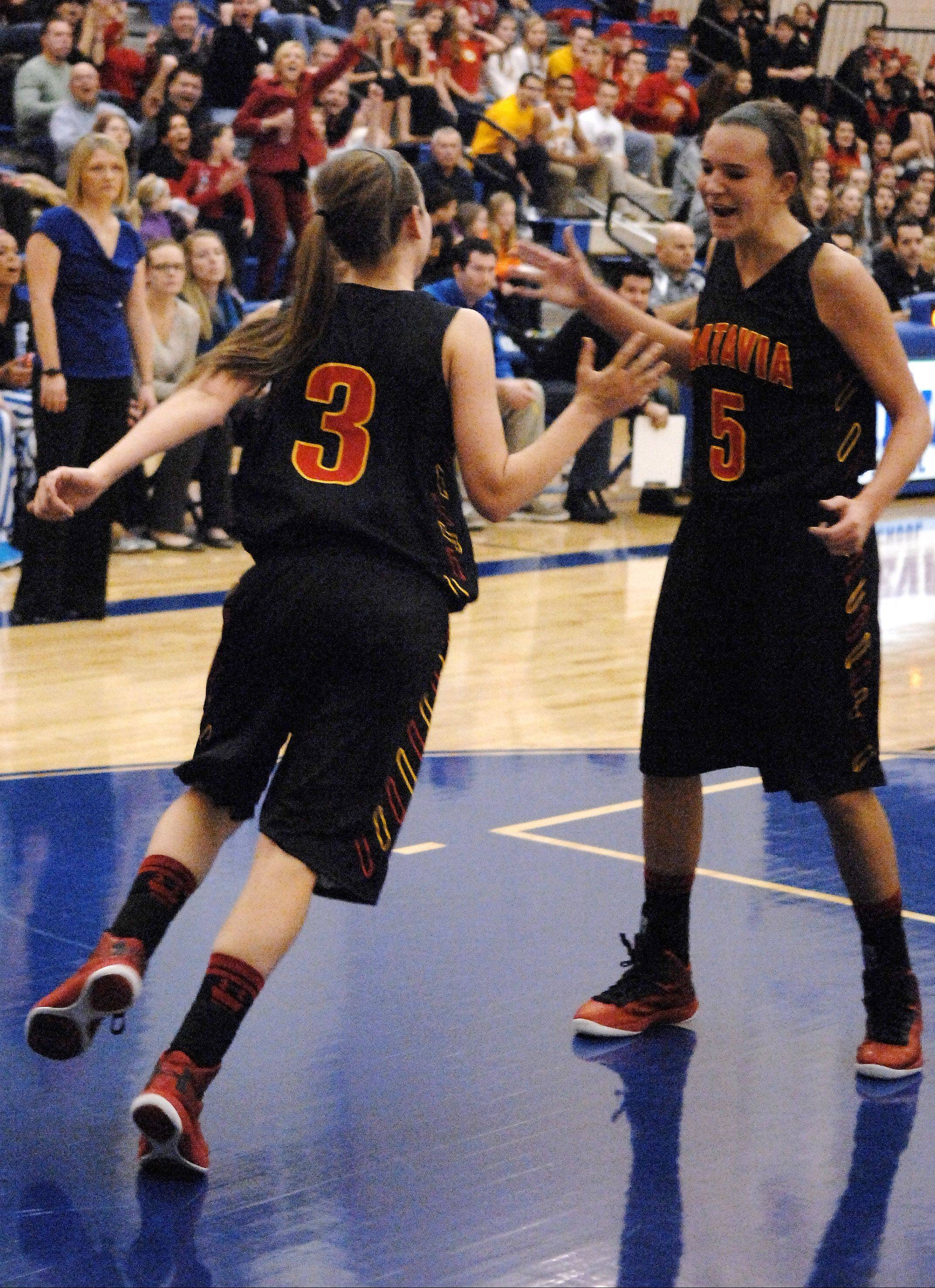 Batavia's Liza Fruendt, right, congratulates Bethany Orman after a basket Friday against Geneva. Orman is one of two freshmen who have been a big part of the team's 5-3 start.