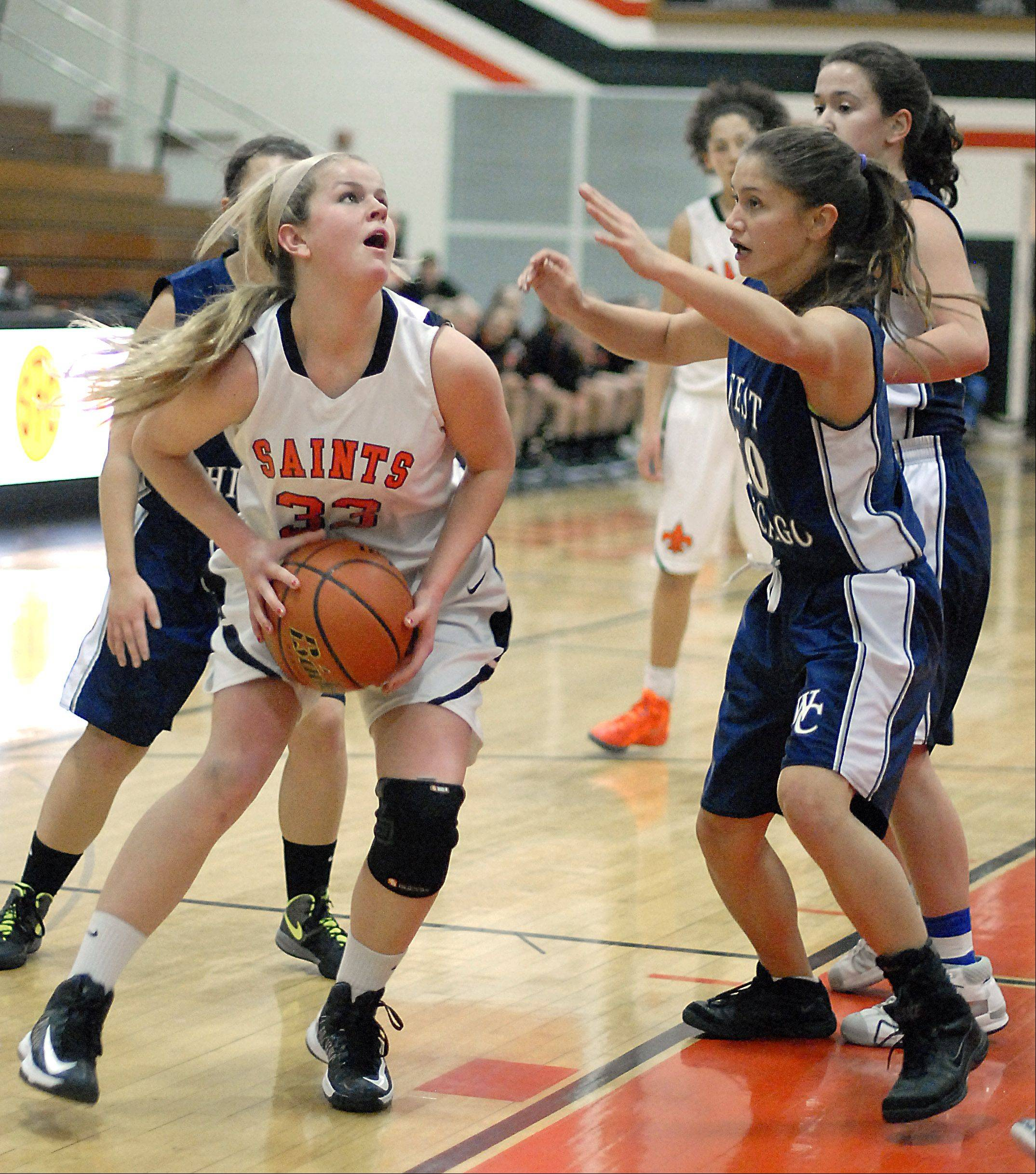 St. Charles East's Hannah Nowling looks to shoot over a block by West Chicago's Amanda Gosbeth in the second quarter on Tuesday, December 4.