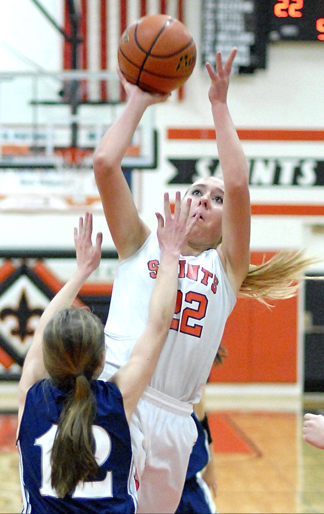 St. Charles East's Anna Bartels sinks a shot over a block by West Chicago's Mae Elizabeth Gimre in the second quarter on Tuesday, December 4.