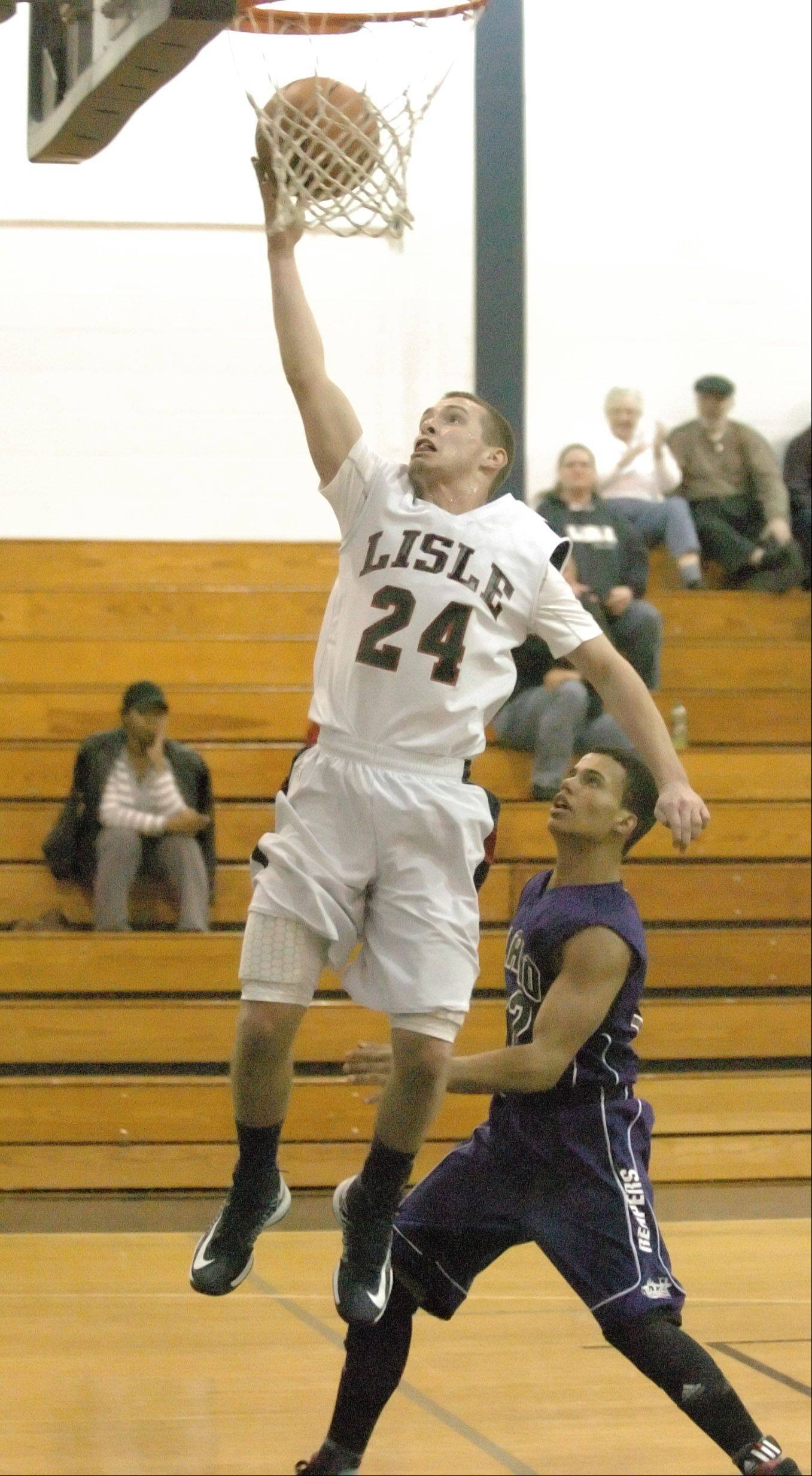 Cody Monson of Lisle brings one to the net during the Plano at Lisle boys basketball game Tuesday.