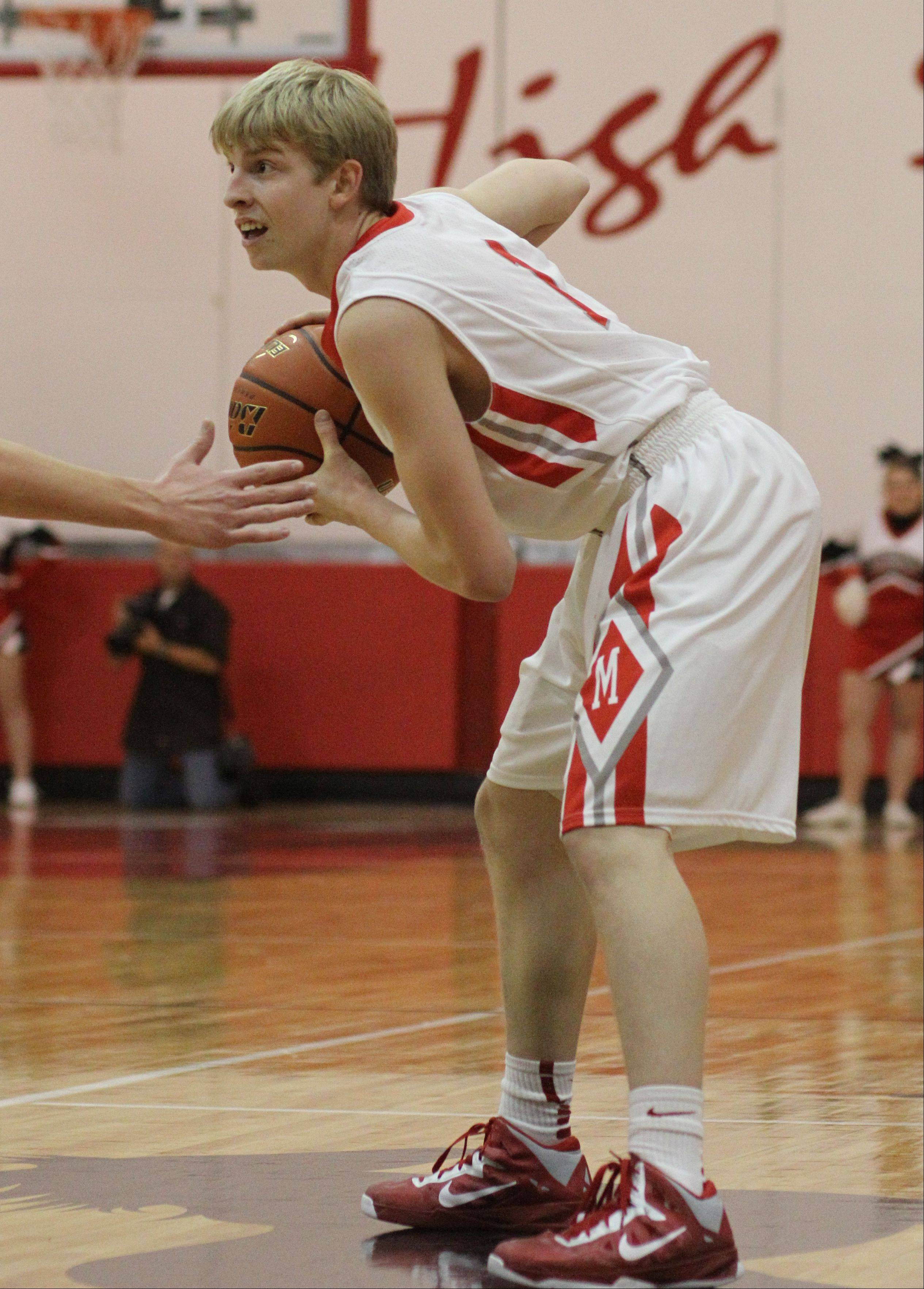 Images from the Lake Zurich at Mundelein boys basketball game on Tuesday, Dec. 4.