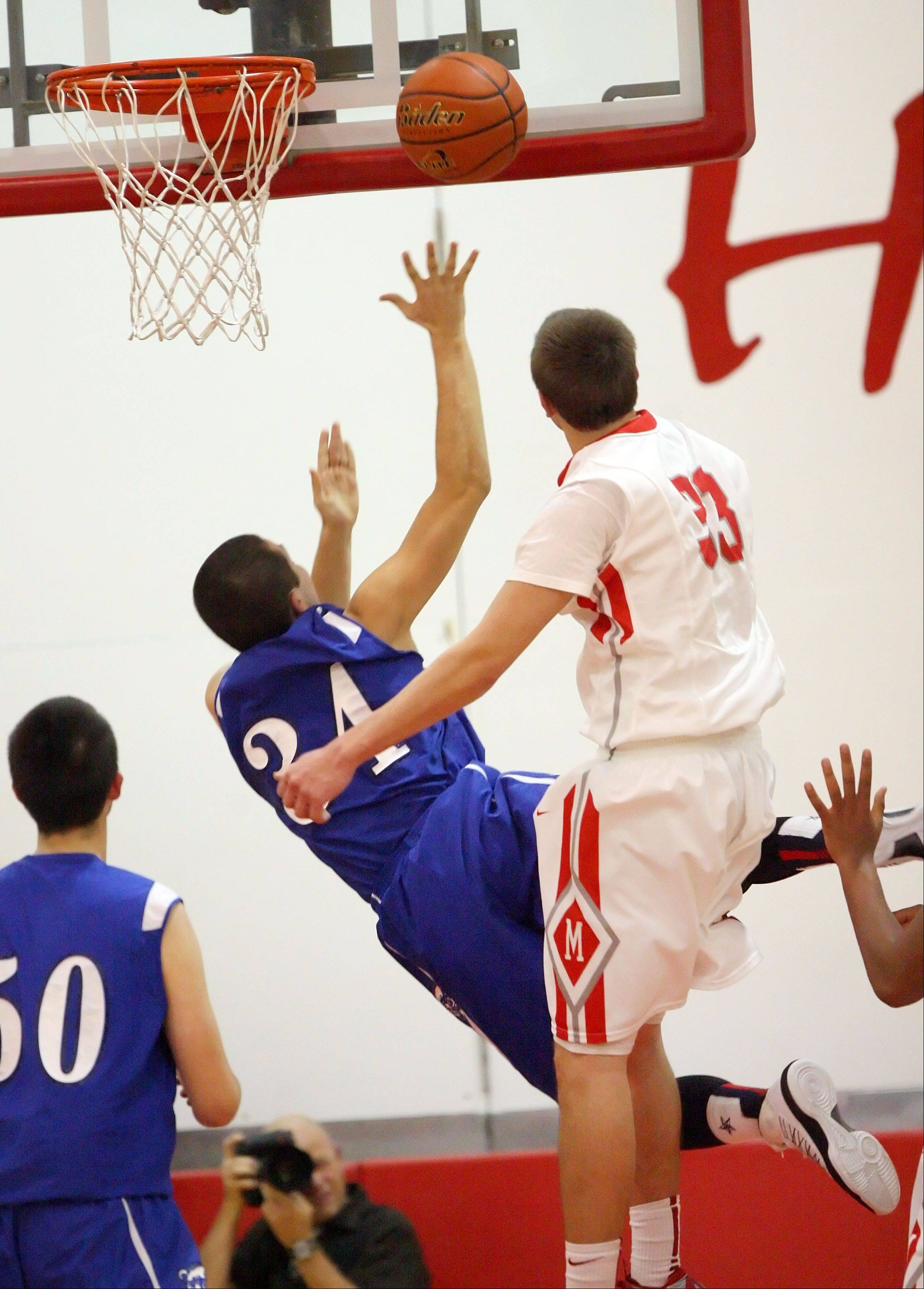 Lake Zurich's Mike Travlos, left, drives past Mundelein's Sean O'Brien.