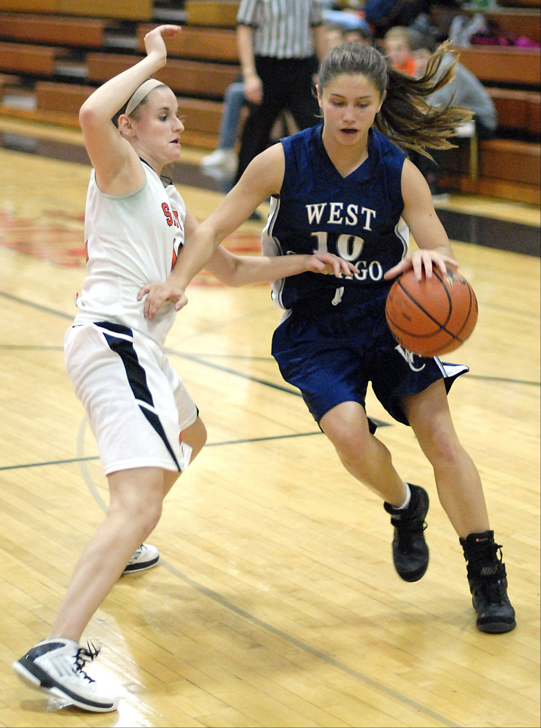 St. Charles East's Paige Jordan attempts to stop West Chicago's Amanda Gosbeth.