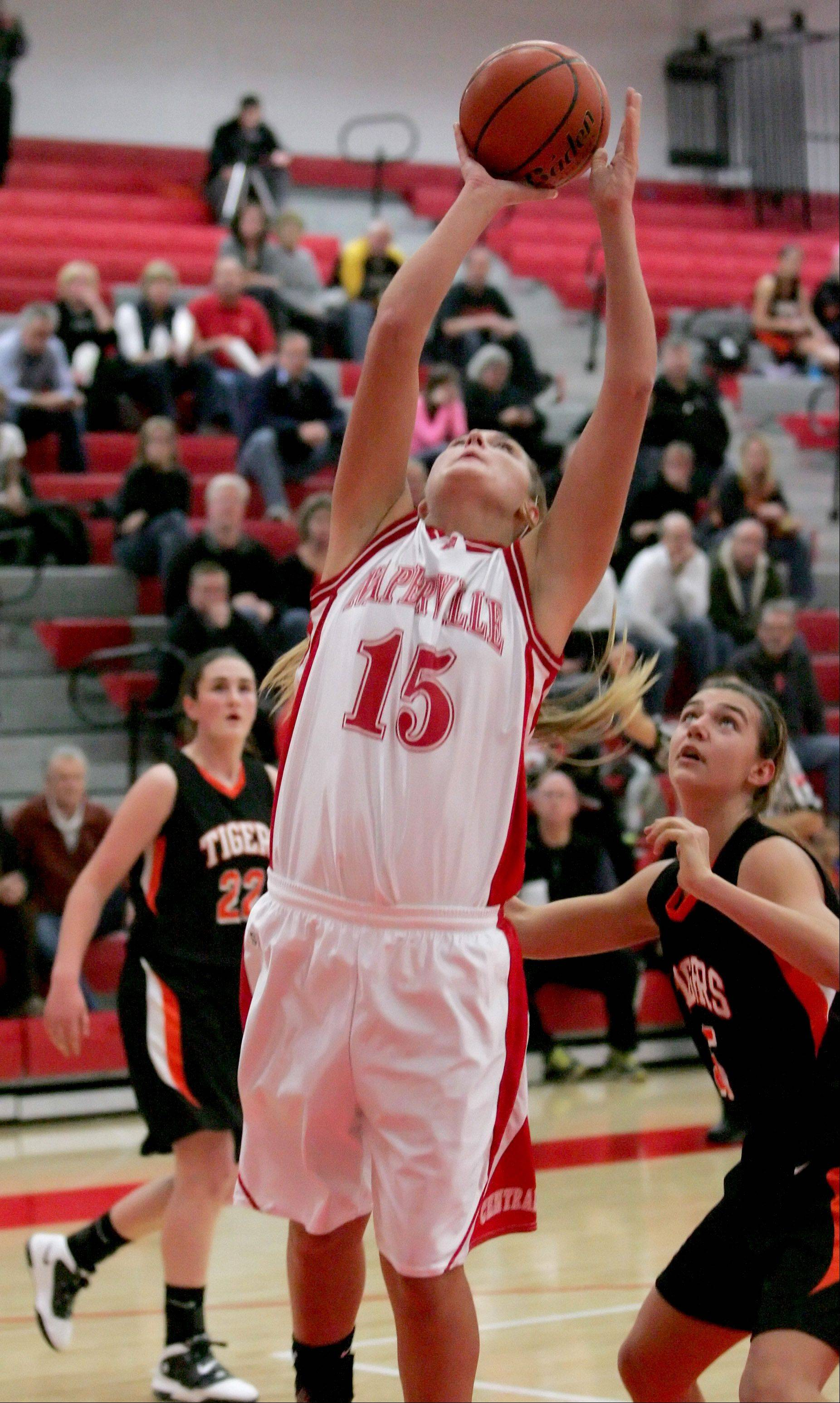 Victoria Trowbridge of Naperville Central shoots the ball against Wheaton Warrenville South.