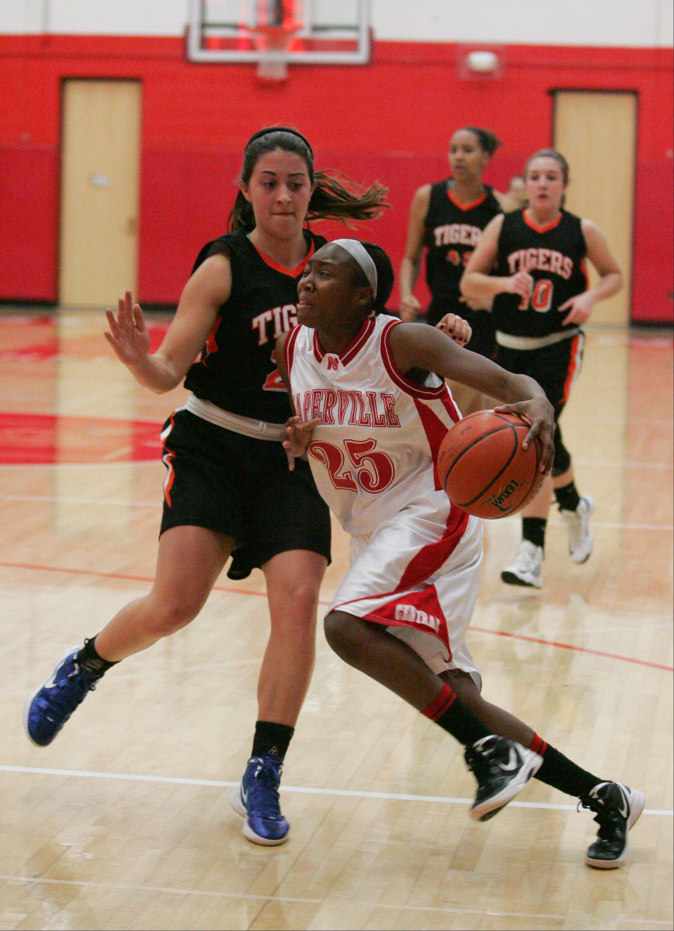 Naperville Central High School hosted Wheaton Warrenville South High School Tuesday night for girls basketball.